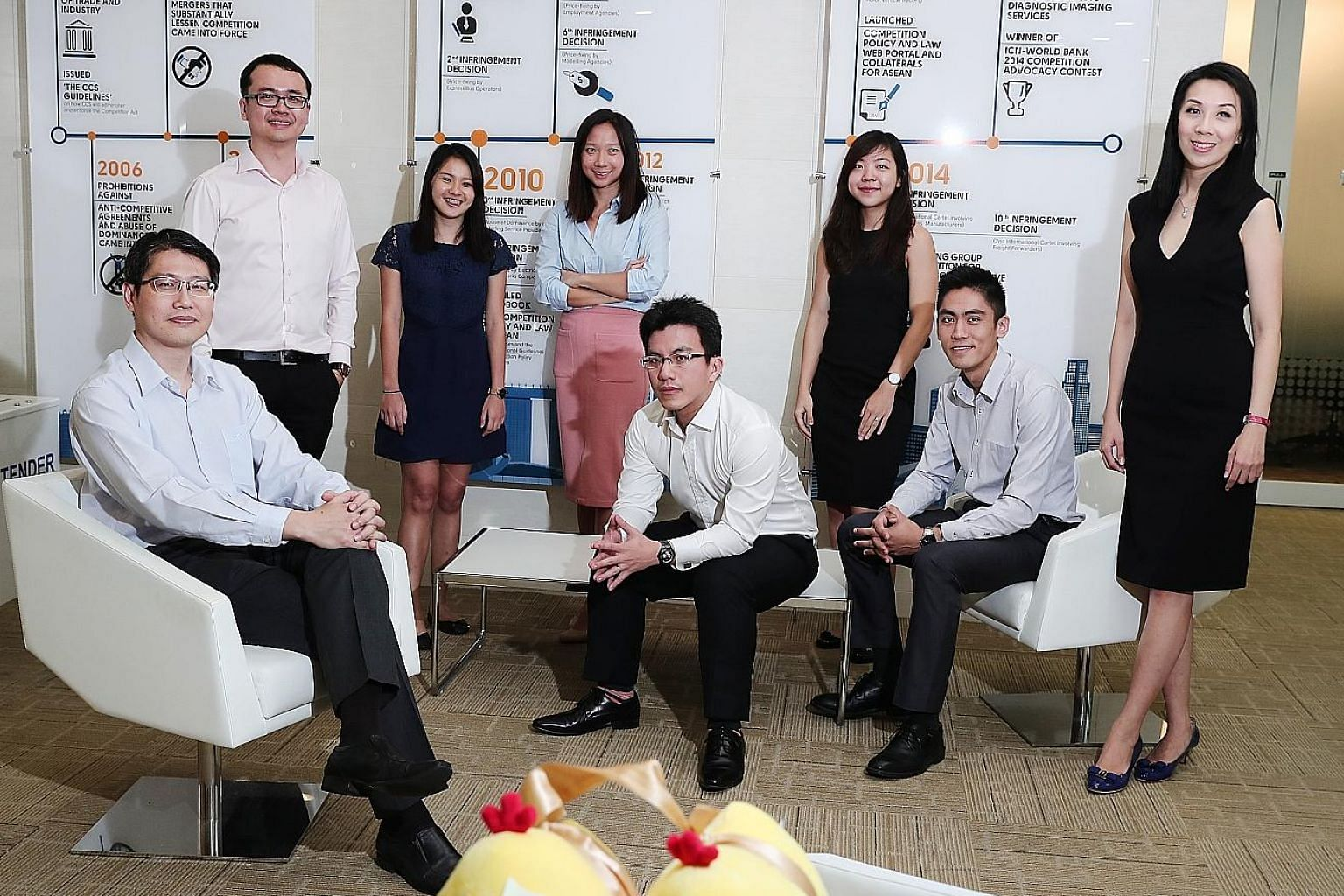 (From left) Team leader Kong Weng Loong, deputy director of the CCCS' business and economics division, with team members Lim Wei Lu, Sarah Tan, Ethel Lin, Tham Chang Xian, Janet Chua, Nicholas Sim and Lee Wan Yi, who worked on the price-fixing case.
