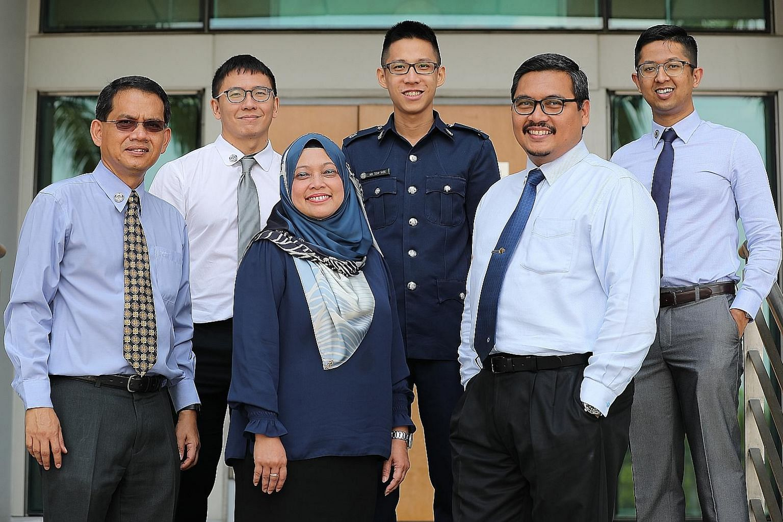 Among those honoured were (from left): Mr Mohamed Zulkifli Kassim, senior manager, community engagement unit, CNB; Mr Soh Weng Hon, manager (capability development), MSF; Ms Salina Samion, principal psychologist, CNB; Mr Ng Tow Wee, staff officer, cl