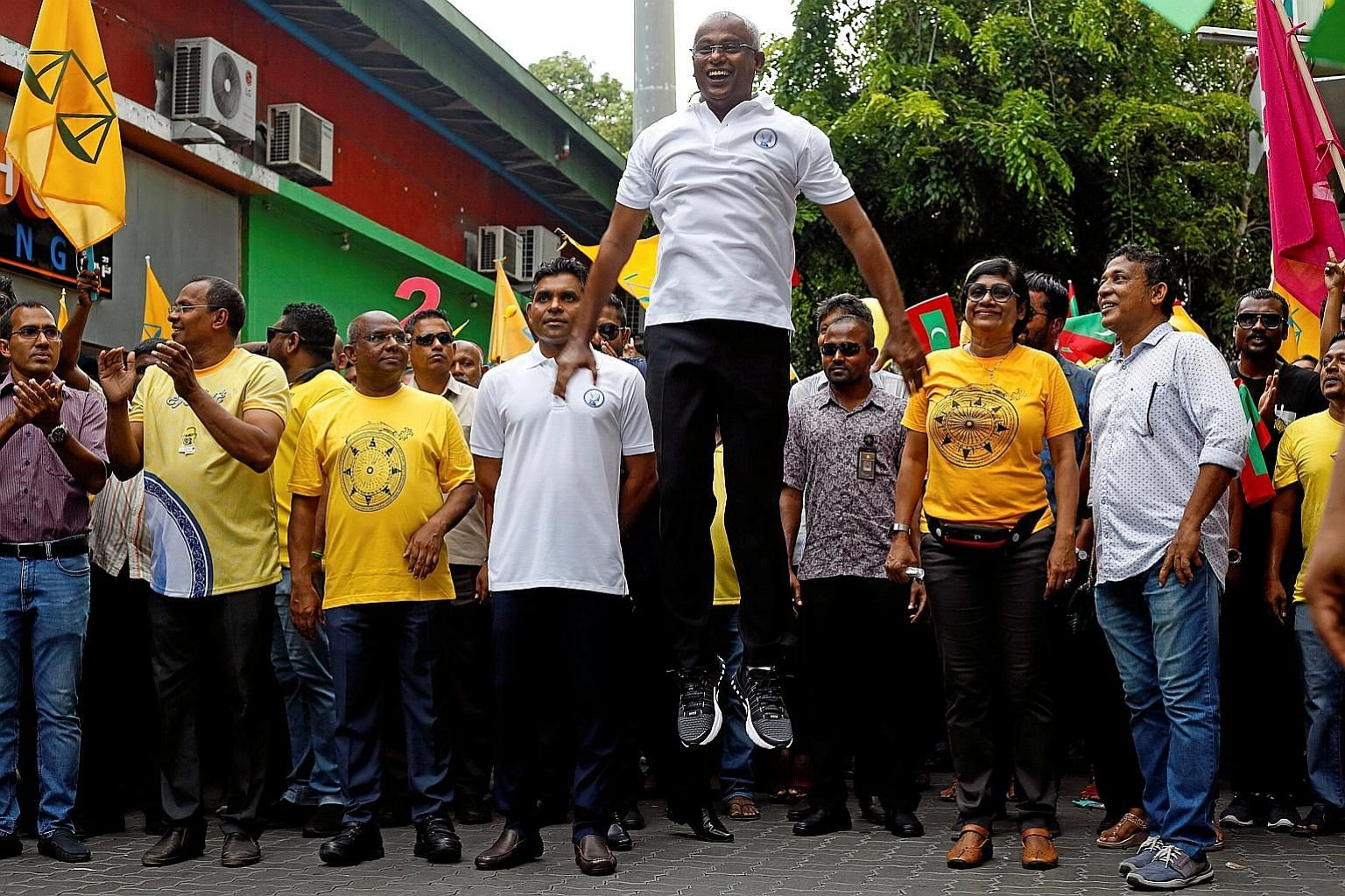 Mr Ibrahim Mohamed Solih of the Maldivian Democratic Party in an exuberant moment during campaigning in the Maldives' presidential election last week. The opposition candidate on Sunday won the election and the current president has conceded defeat a