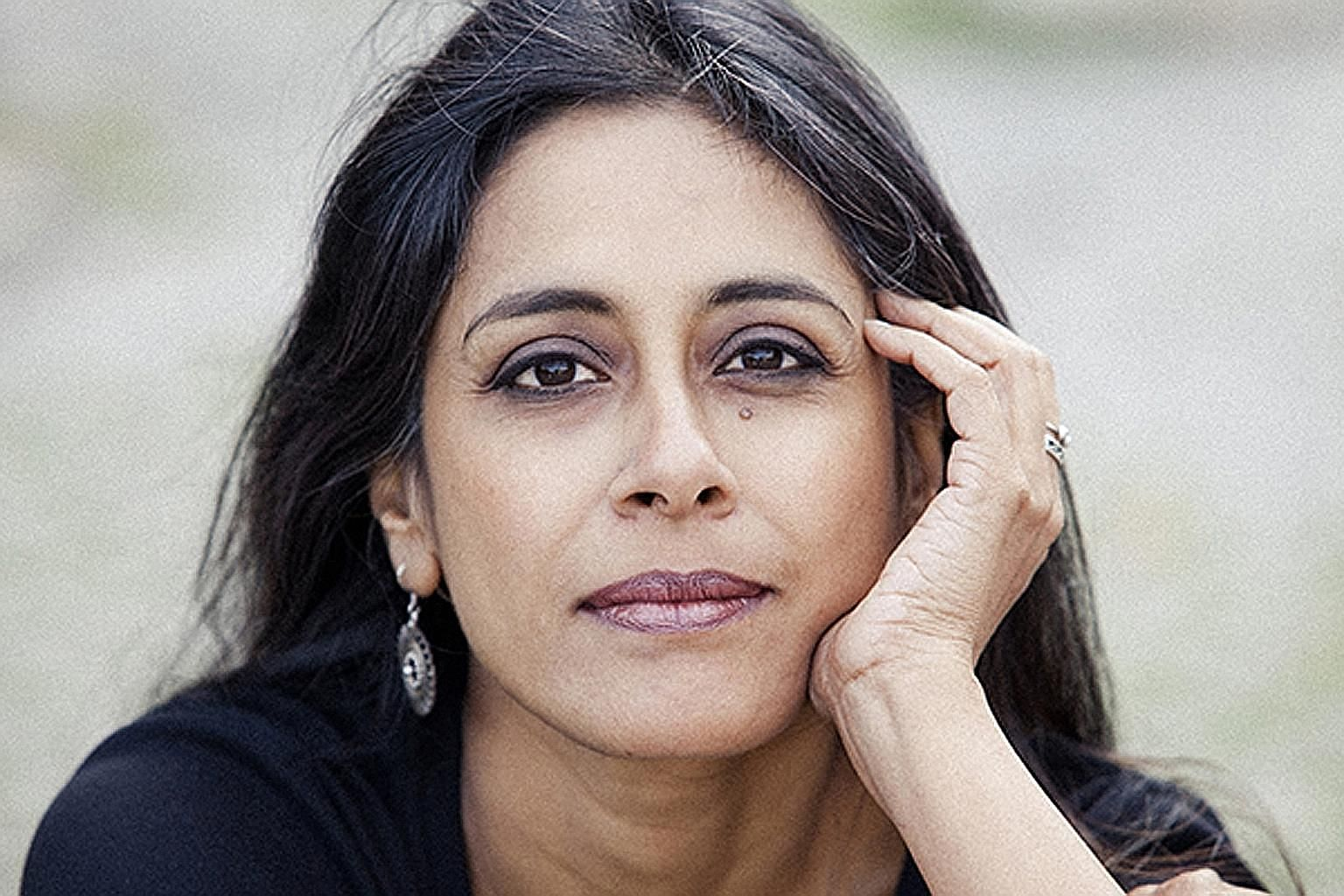 Writer Anuradha Roy (top) delves into the trauma and regret faced by a family in India in All The Lives We Never Lived.