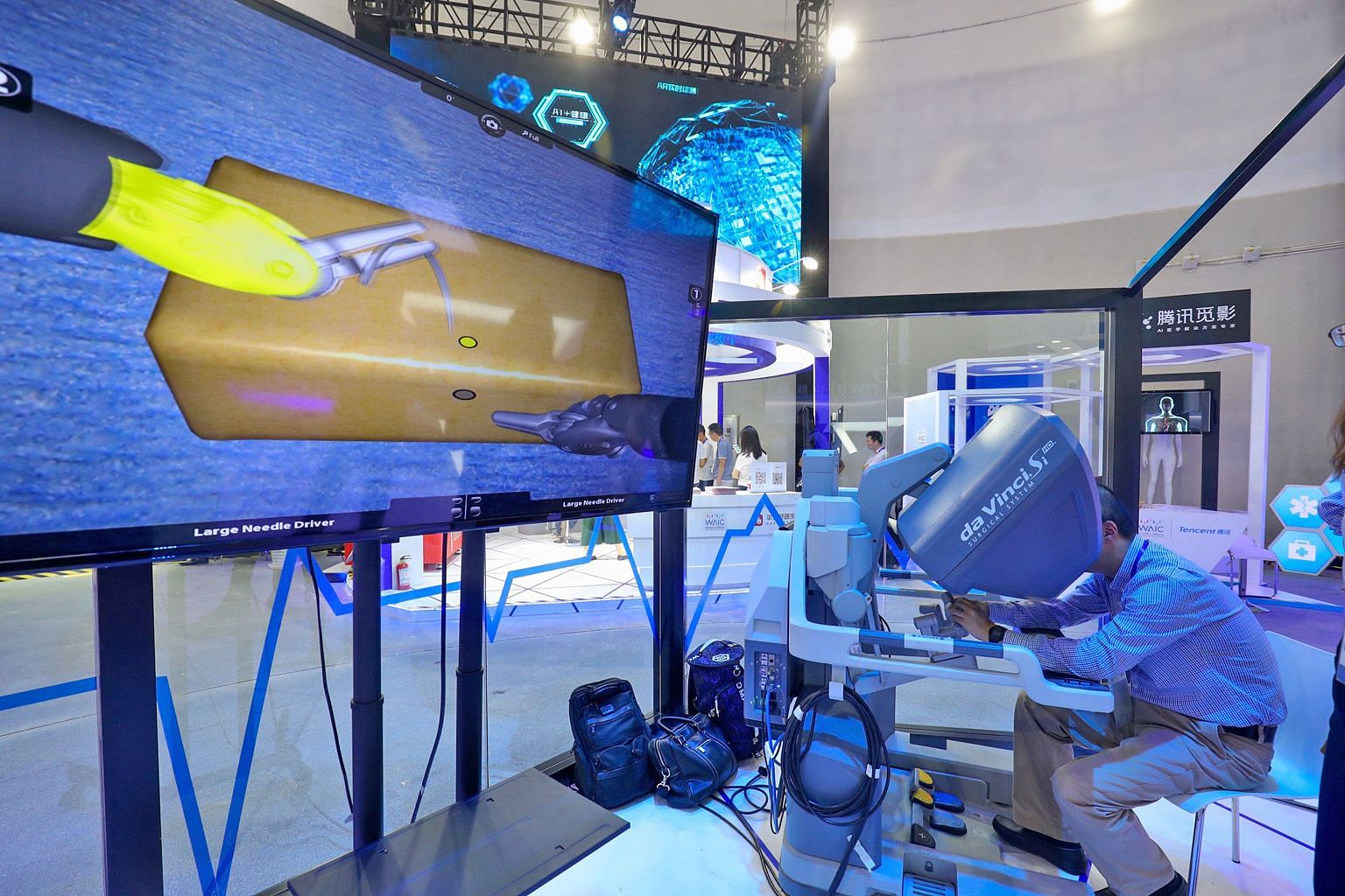 A visitor at the World Artificial Intelligence Conference in Shanghai experiencing a robotic surgical technique last week. The movement from discovery to implementation marks a significant shift in AI's centre of gravity - away from the United States