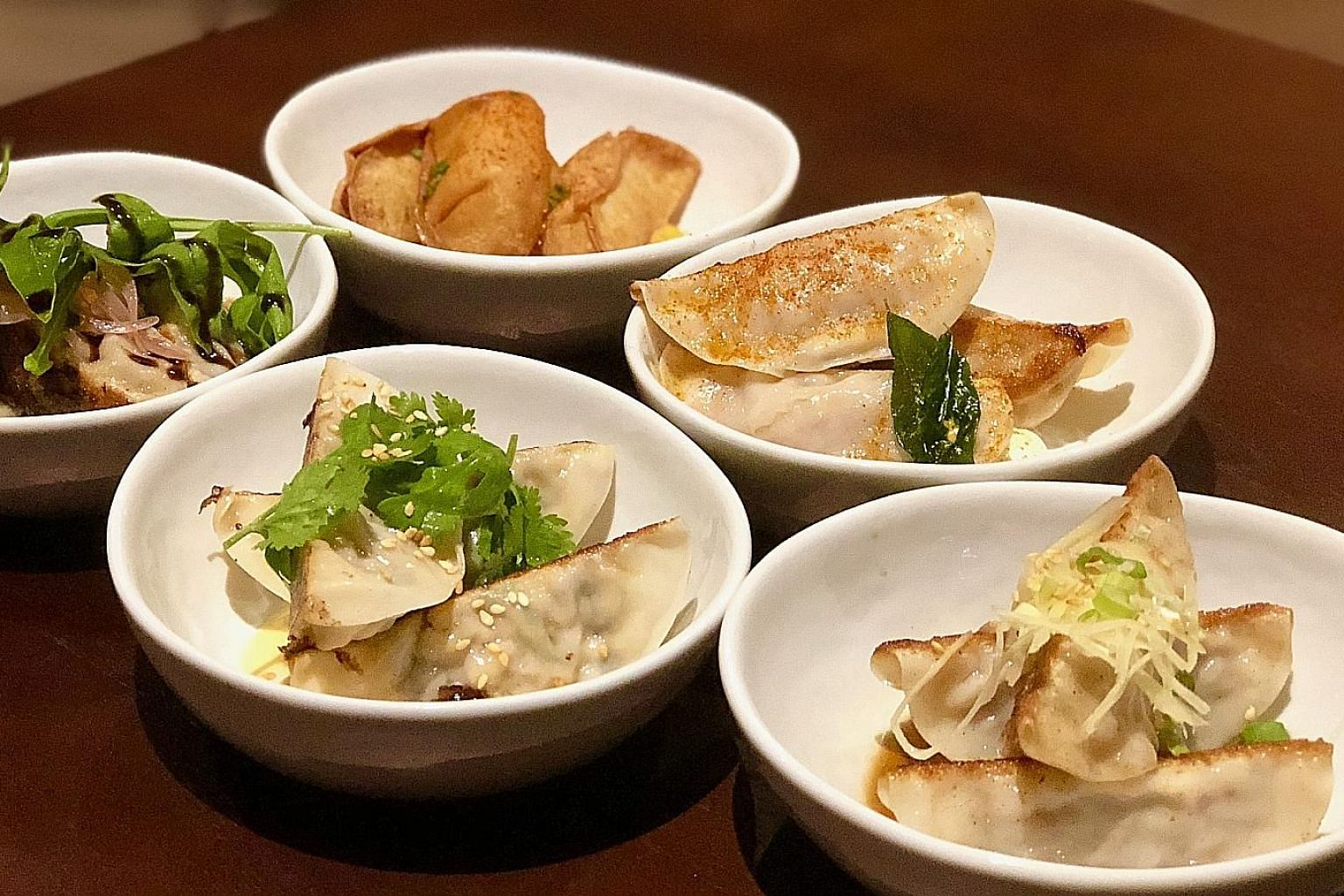 Assorted dumplings are priced at $7 or $8 a serving.