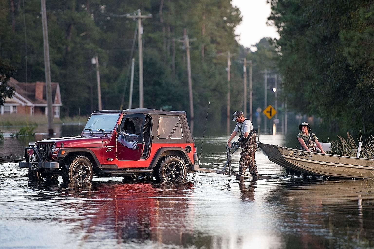 Flooding caused by Hurricane Florence in Bucksport, South Carolina, last week. The United States' strong economic performance could be dented by extreme weather like Hurricane Florence, which could hobble job creation in the affected regions.