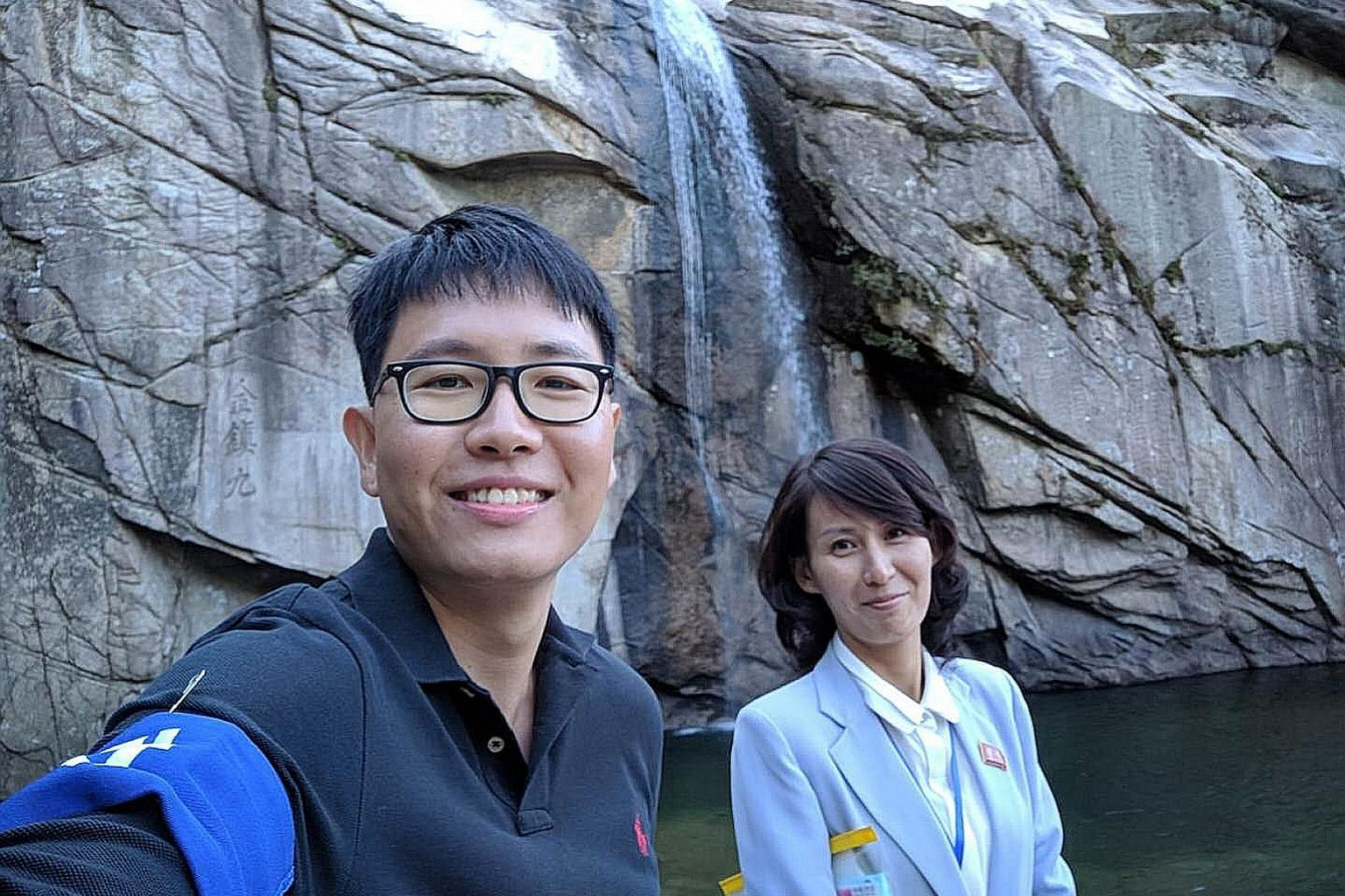 Straits Times correspondent Lim Yan Liang and Mrs Kim Hyon Ju, a card-carrying member of the Workers' Party of Korea, at the Pakyon Waterfall, regarded as one of the most famous waterfalls on the Korean peninsula.