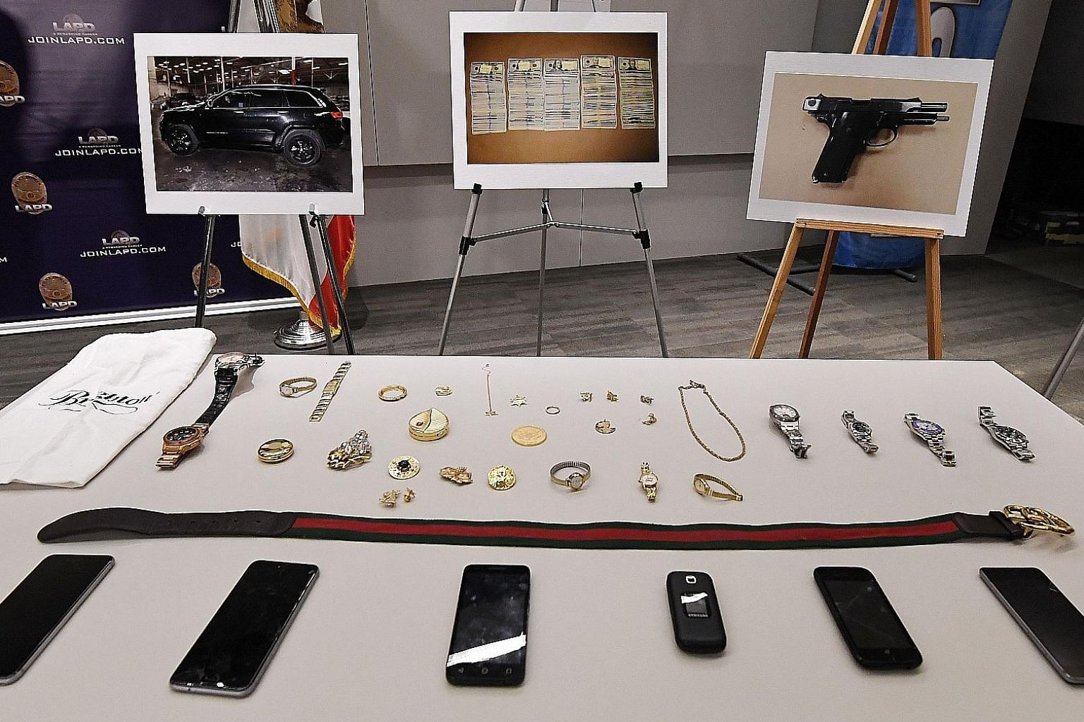 Stolen goods on display at a Los Angeles Police Department press conference to announce the arrest of four suspects in connection with a spate of high-profile burglaries at the homes of singers, sportsmen and other celebrities in Los Angeles, Califor