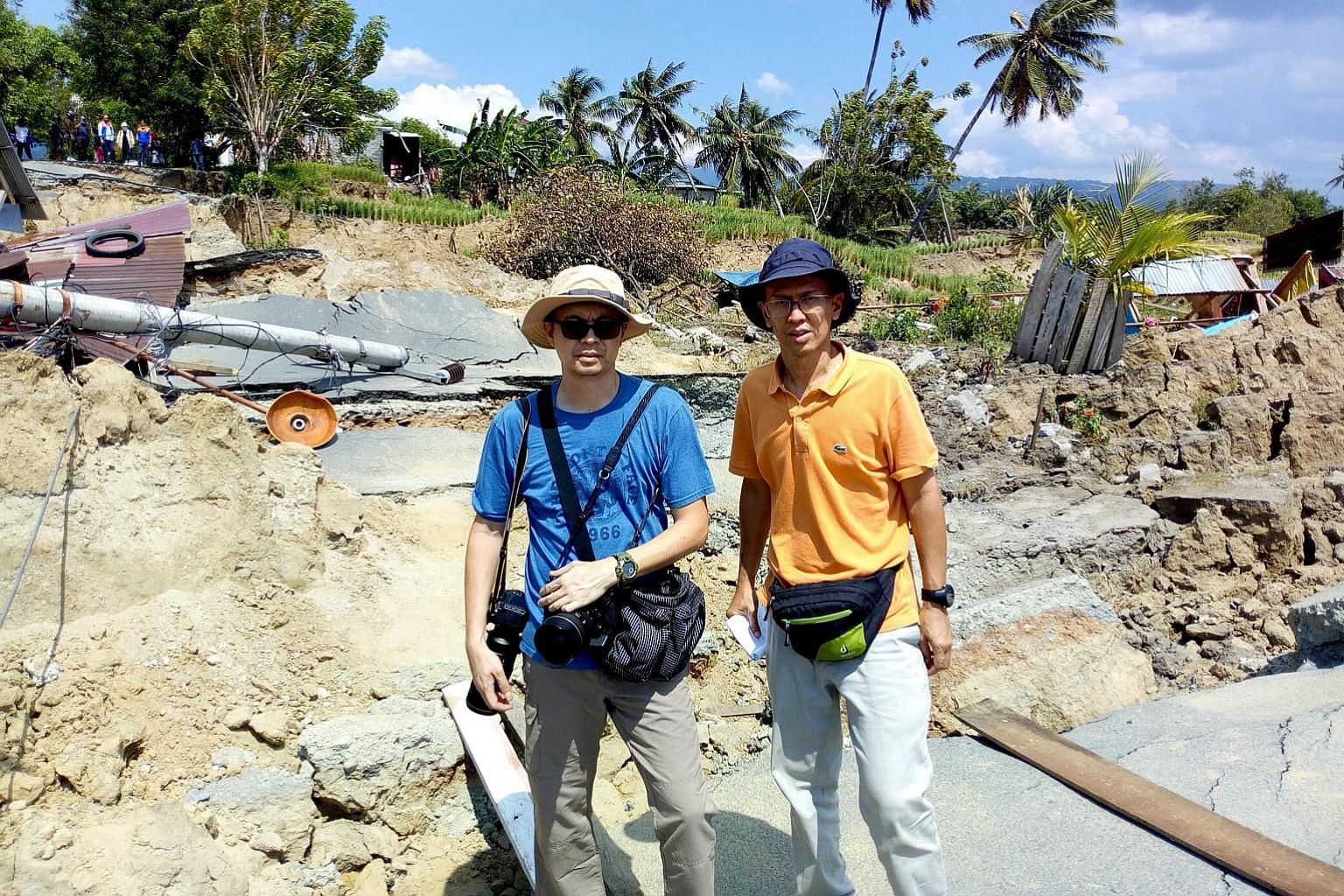 The writer (far left) and Indonesia Correspondent Wahyudi Soeriaatmadja in Palu. They had arrived at night last Tuesday. The city was like a war zone with widespread devastation.