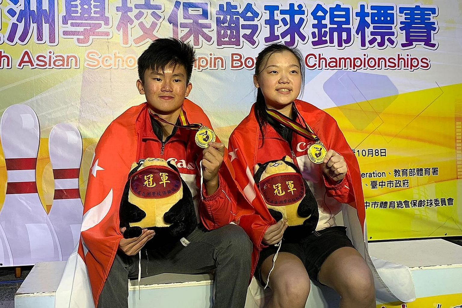 Eugene Yeo and Quek Lu Yi won the boys' and girls' Masters respectively on the final day of the Asian Schools Tenpin Championships yesterday in Chinese Taipei.
