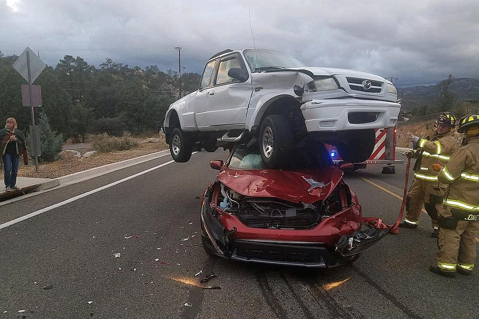 "Firefighters in Prescott, Arizona, were surprised to find a white pickup atop a red sedan on Sunday after receiving reports of a three-vehicle accident. Incredibly, no one was injured in the ""remarkable crash"", as the Prescott Fire Department called"