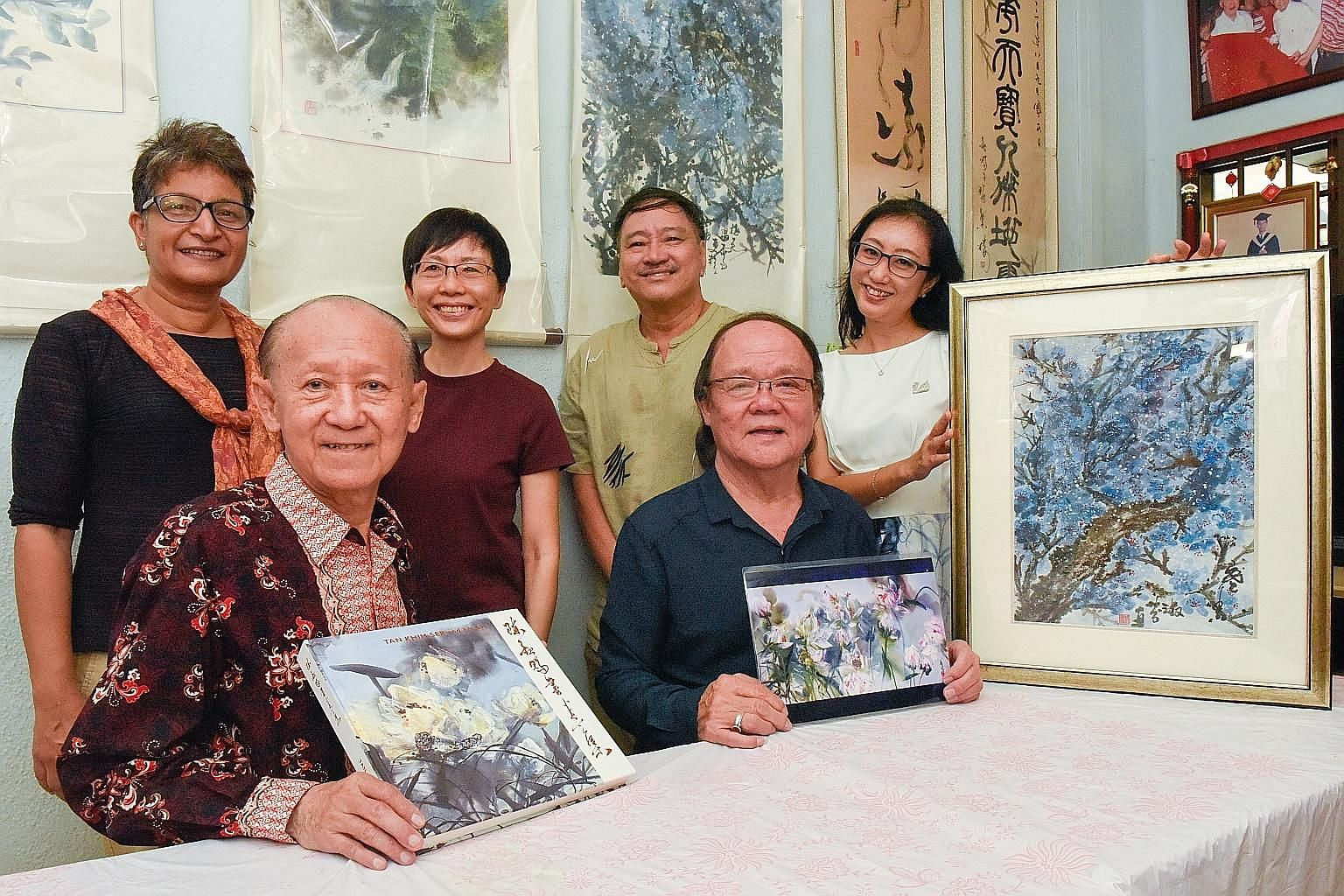 Artist Tan Khim Ser (bottom left) and Straits Times subscribers (clockwise from top left) Kala Sundaram, Lena Lim, Lai Fook Kee, Yang Shwn Fen and Benny Khong, whose paintings, created at a workshop with Tan, will be showcased at a the art exhibition