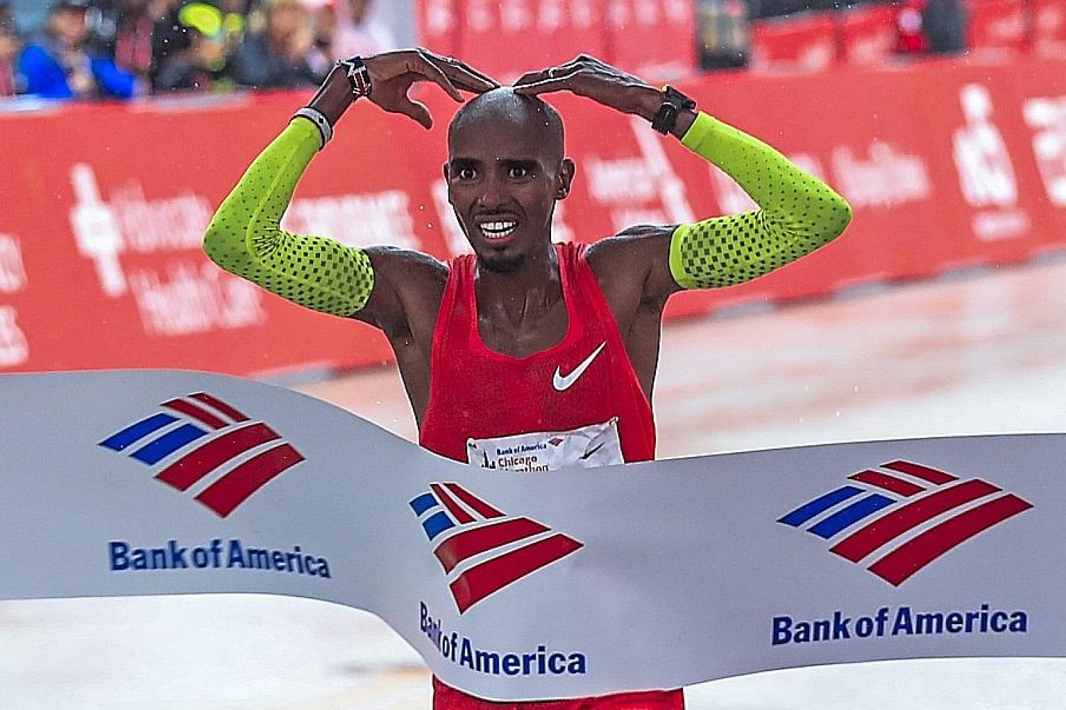 Briton Mo Farah crosses the line to win the 41st Chicago Marathon on Sunday, announcing himself as a threat to world record holder Eliud Kipchoge of Kenya.