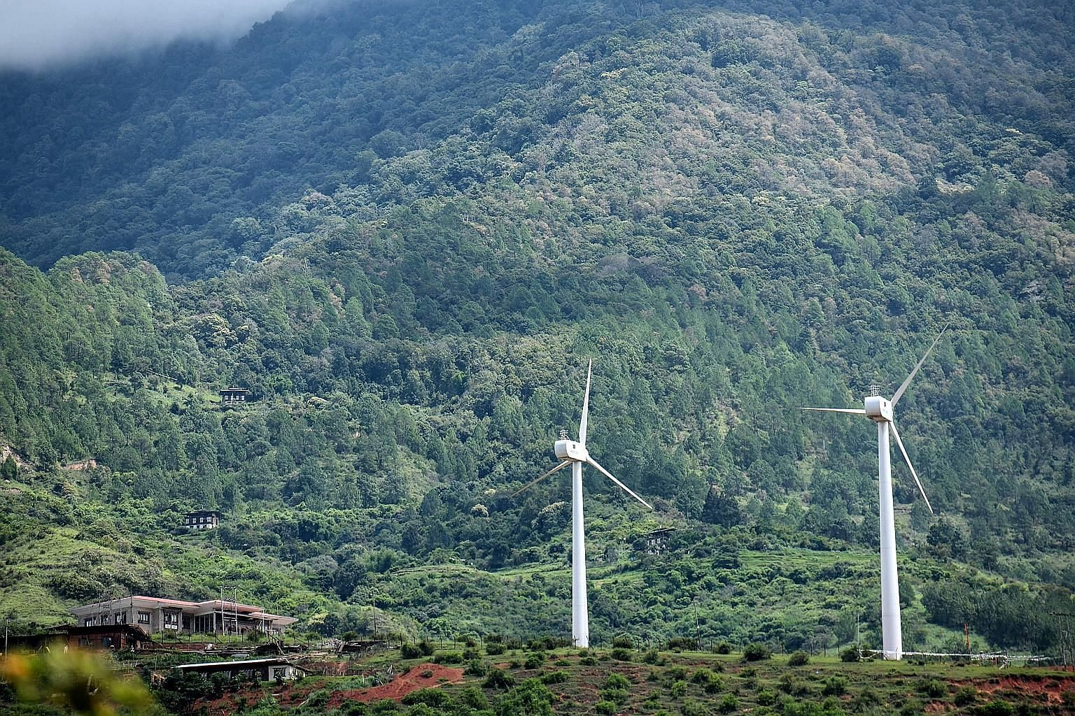 A pair of wind turbines in Rubesa village in Wangdue. They speak of Bhutan's giant stride as the only carbon negative country in the world.