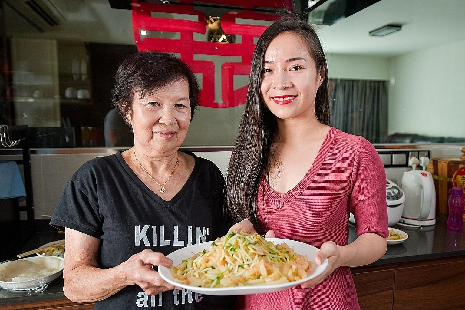(Clockwise from top left) Tapioca starch in a bowl, dried prawn with garlic and chilli, cookbook, porridge cake strips and a plate of coriander and bean sprouts. Lace Zhang with her grandmother, Madam Ong Keow Lan, whom she learnt to cook porridge ku