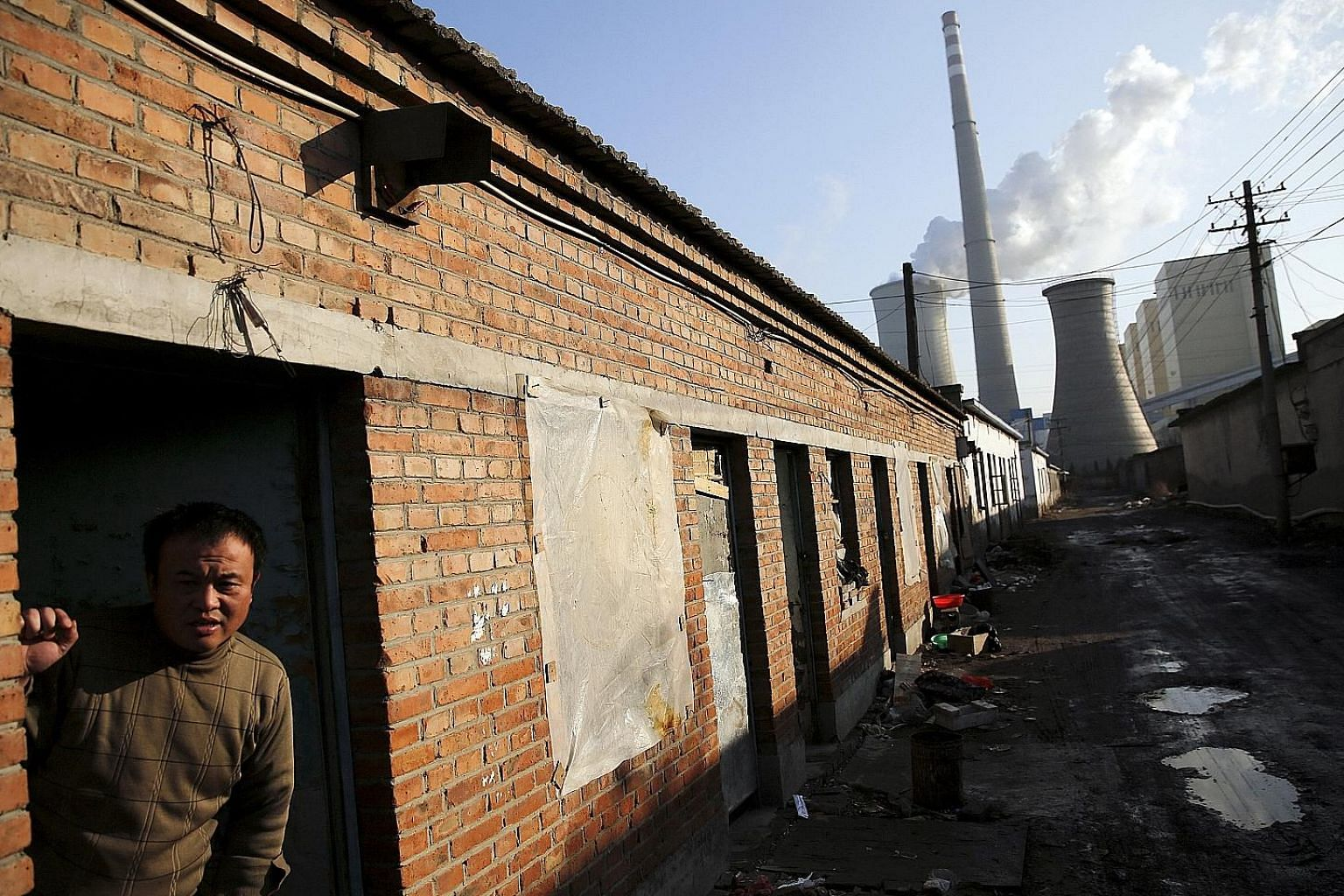A migrant worker at his accommodation in an area next to a coal-fired power plant in Beijing. Private capital is keen to support the Chinese government's policy priorities to shift economic growth towards a less resource-intensive, more consumer-cent