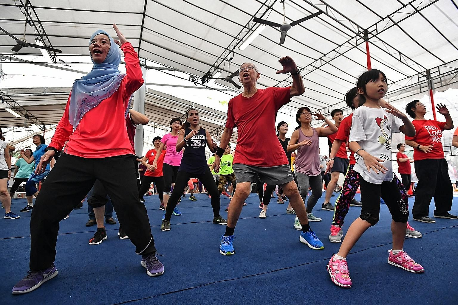 Residents doing a KpopX dance at Toa Payoh Central yesterday, during the launch of the Programme for Active Living, which aims to encourage residents in Bishan-Toa Payoh GRC to develop a lifestyle of regular exercise.