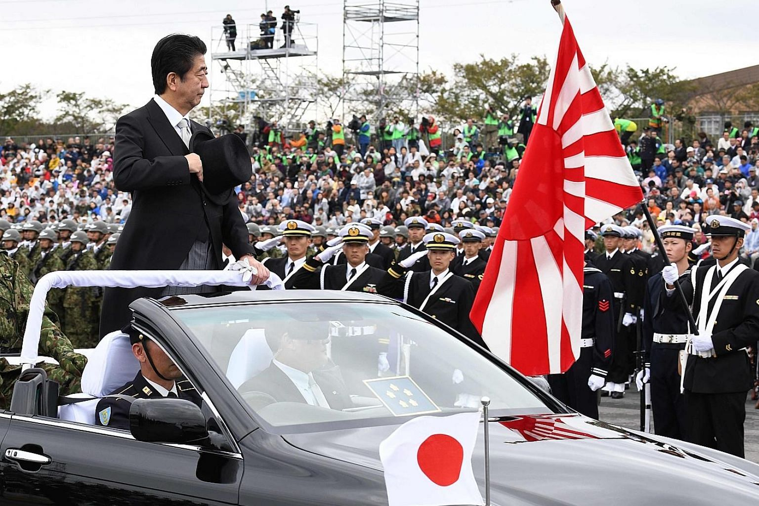 Japanese Prime Minister Shinzo Abe at a military parade in Asaka yesterday. In the poll, citizens of Japan and China see security as a big bugbear in building trust.