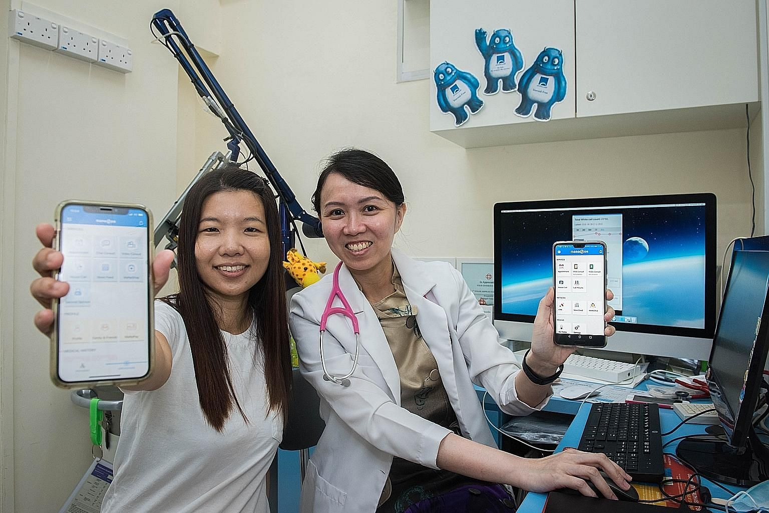 Dr Rachel Teoh (at right) and patient Ferlene Tan showing features of the MaNaDr app on their phones. The app is one of many offering more convenient access to doctors and pharmacists here.