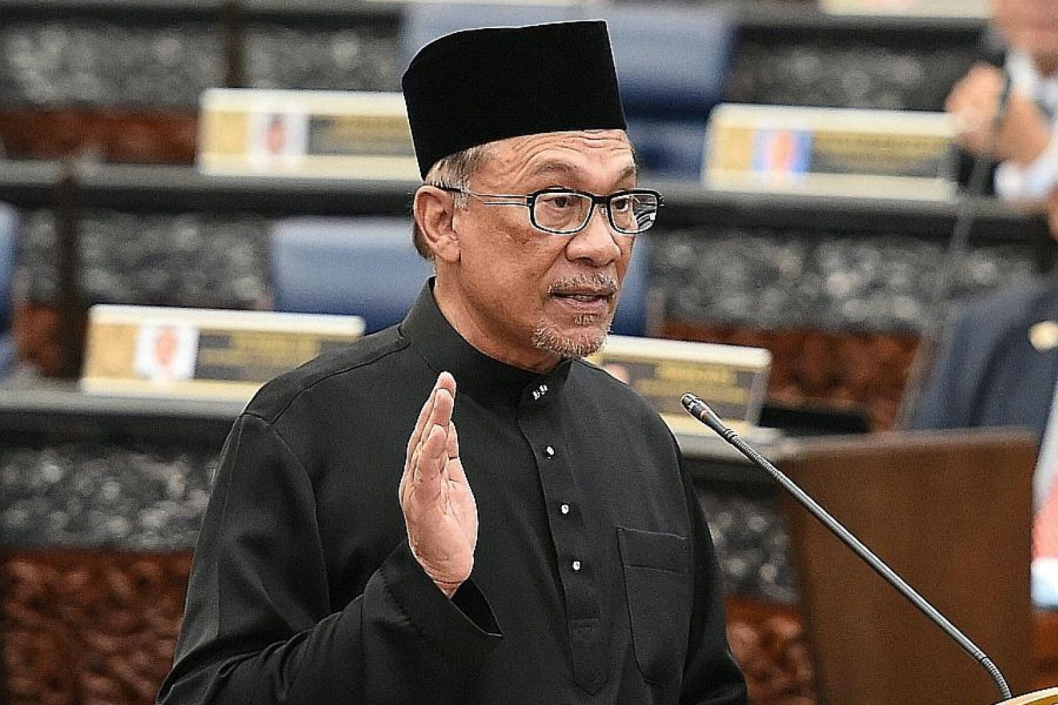 Datuk Seri Anwar Ibrahim taking the oath as a Member of Parliament during yesterday's swearing-in ceremony at Malaysia's Parliament House in Kuala Lumpur.