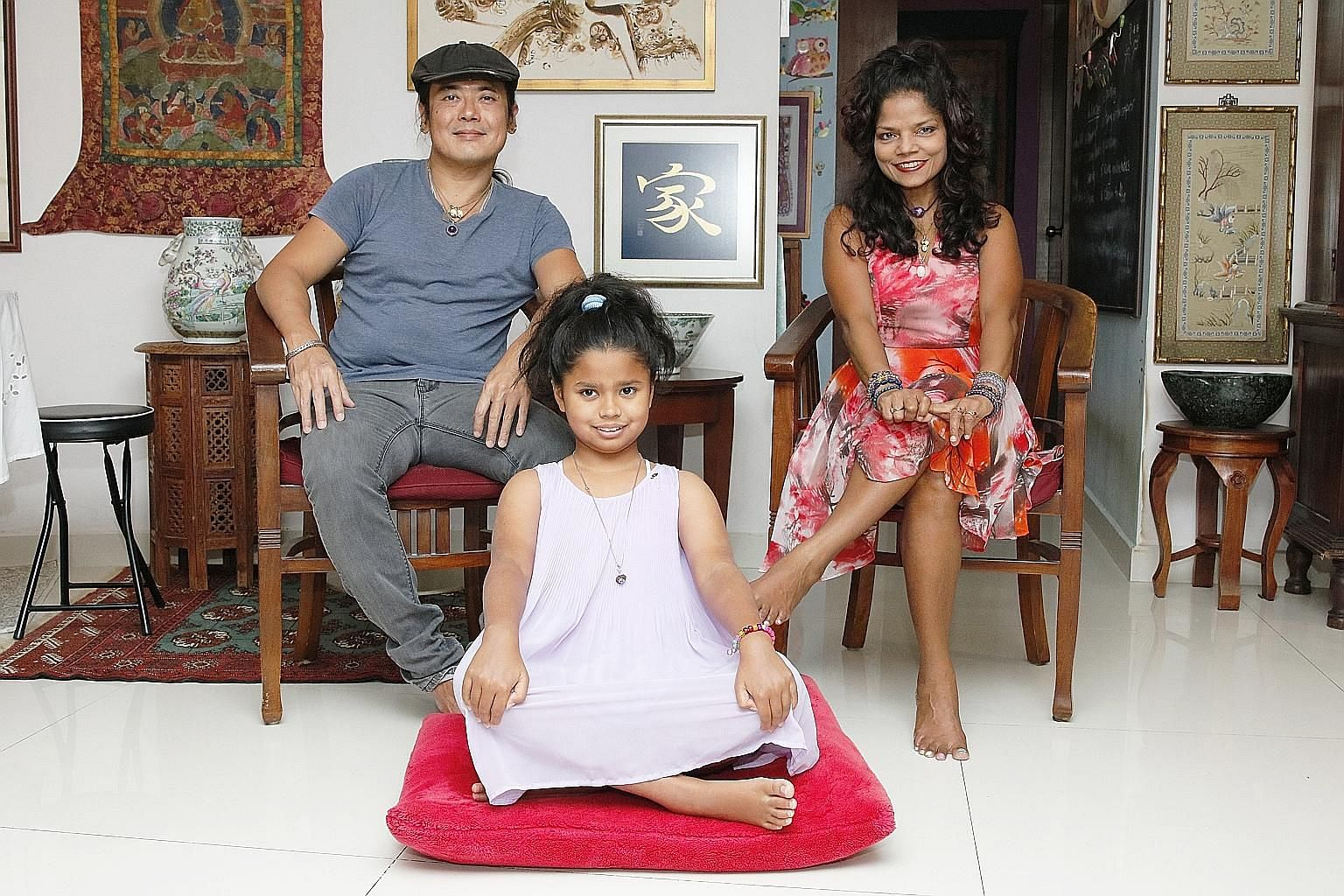 Home chef Chris Choo, his TV producer wife Rose Sivam and their daughter Aleia invite people who may not get to enjoy good food and professional entertainment to their Serangoon North flat every other month. From left: In July, guests tried their han