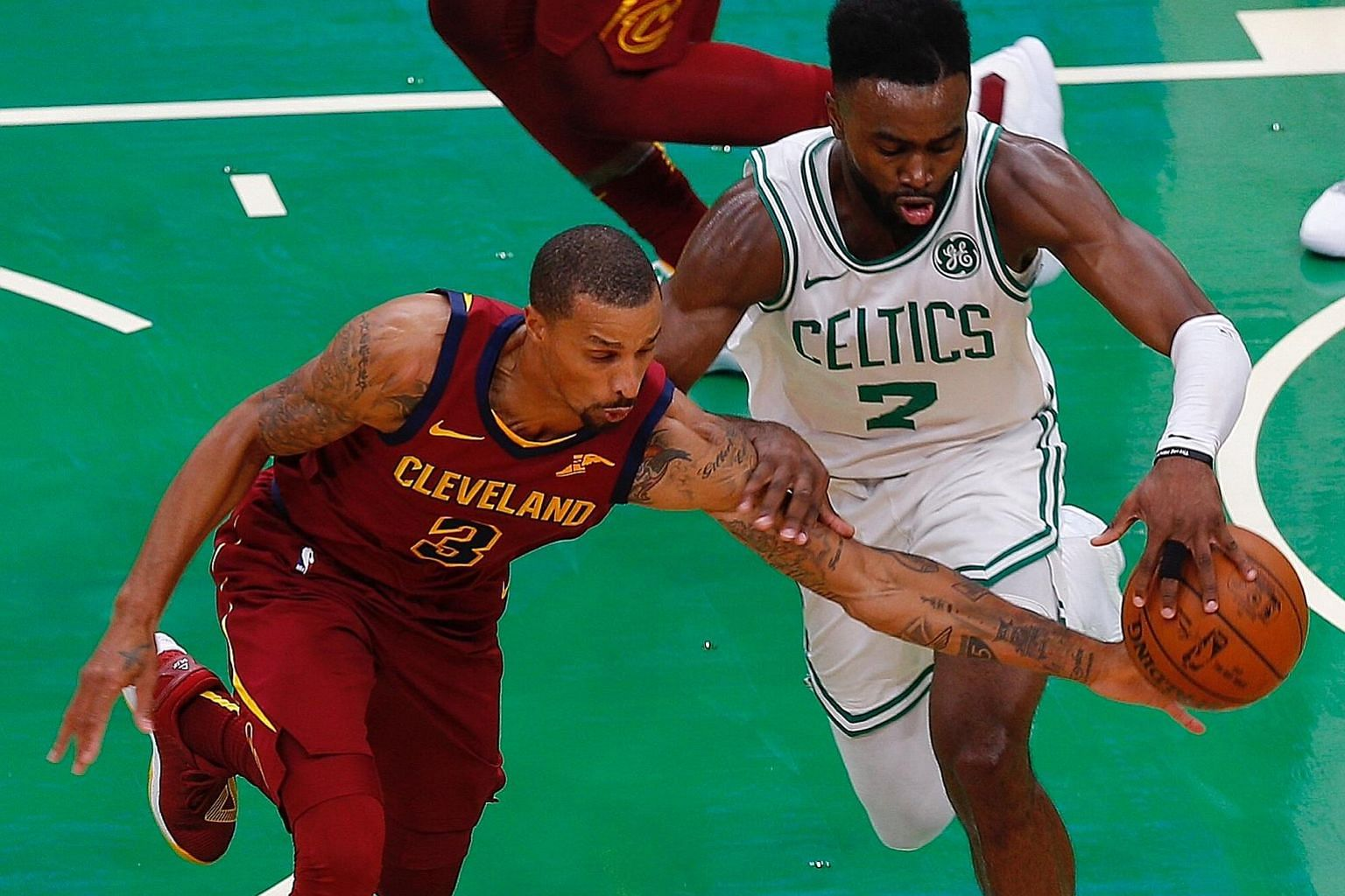 Celtics guard Jaylen Brown and Cavaliers guard George Hill tussling for the ball in their pre-season game on Oct 2. The teams will be vying for supremacy in the Eastern Conference again but Boston have a clear edge after the departure of LeBron James