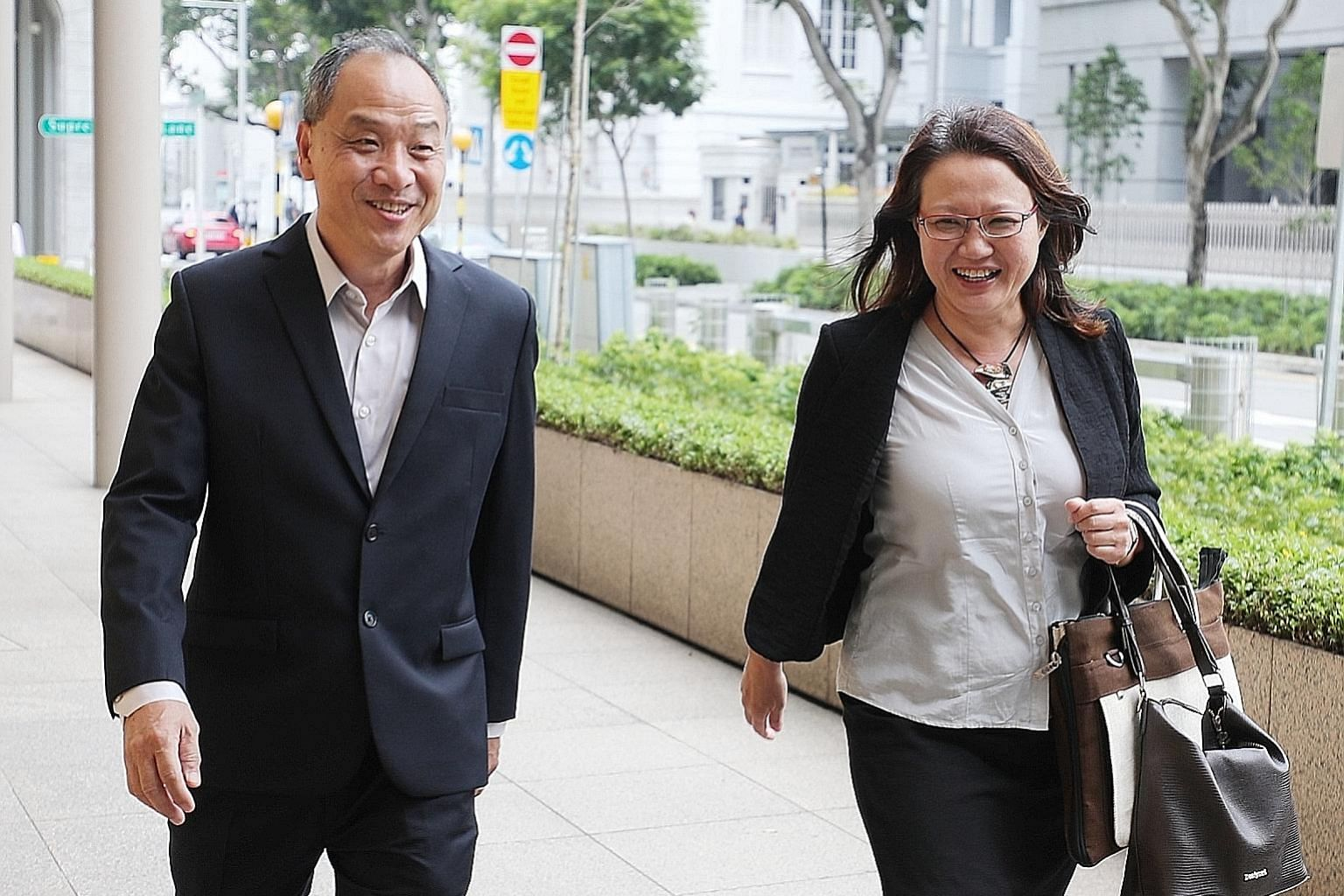 Former Workers' Party chief Low Thia Khiang and WP chairman Sylvia Lim at the Supreme Court yesterday. The eighth day of a multimillion-dollar lawsuit saw sharp exchanges as Senior Counsel Davinder Singh cross-examined Mr Low before a packed courtroo