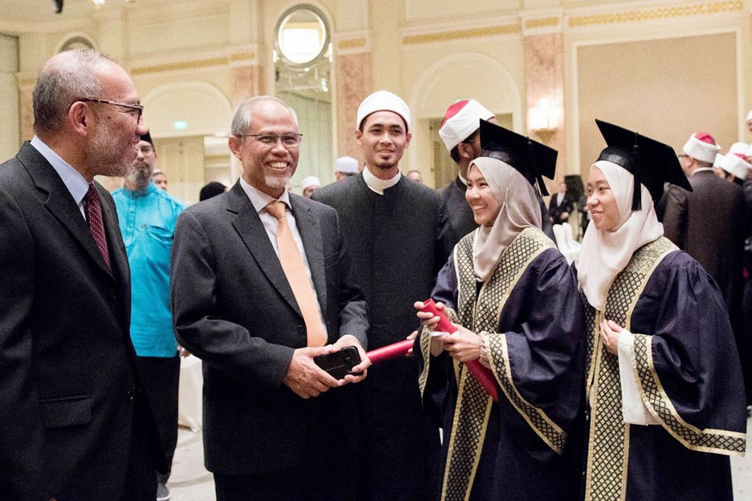Minister-in-charge of Muslim Affairs Masagos Zulkifli mingling with some graduates from the class of 2018 at Cairo's Al-Azhar University on Monday.
