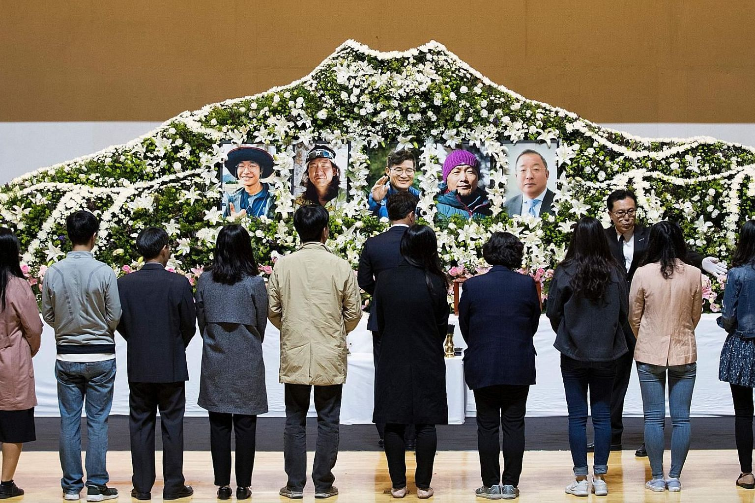 Mourners pay their respects to the five South Korean climbers led by renowned mountaineer Kim Chang-ho (centre) in Seoul. The team was trying to blaze a new route on the south face of Mount Gurja, a 7,193m-high peak located about 216km north-west of
