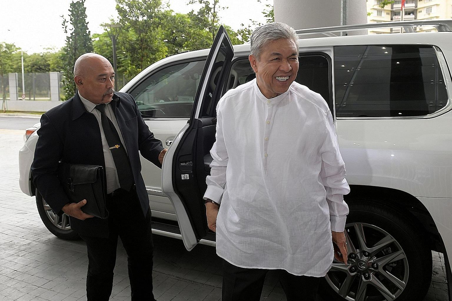 Datuk Seri Ahmad Zahid Hamidi arriving at MACC's headquarters in Putrajaya last Friday to give his statement regarding a probe into misappropriation of funds belonging to his family-owned welfare foundation.