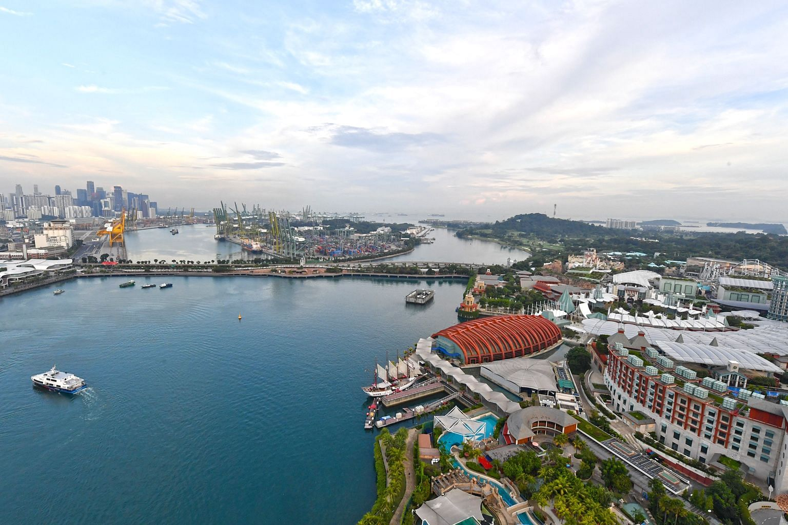 Sentosa (right) is set to get a boost with more attractions and investments, and government agencies are also drawing up development plans for the adjacent Pulau Brani (background). The whole area will be branded as the Southern Gateway of Asia.