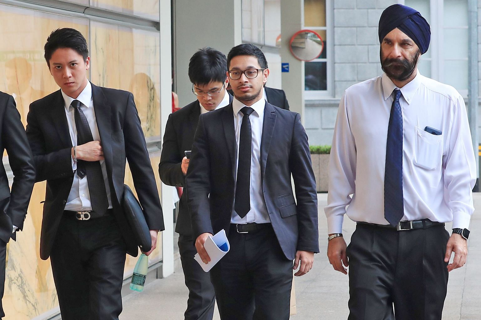 """Senior Counsel Davinder Singh (right) and his legal team. He said Mr Low Thia Khiang had """"directed"""" FMSS to bring Hougang Town Council's staff under its control even before it was officially appointed."""
