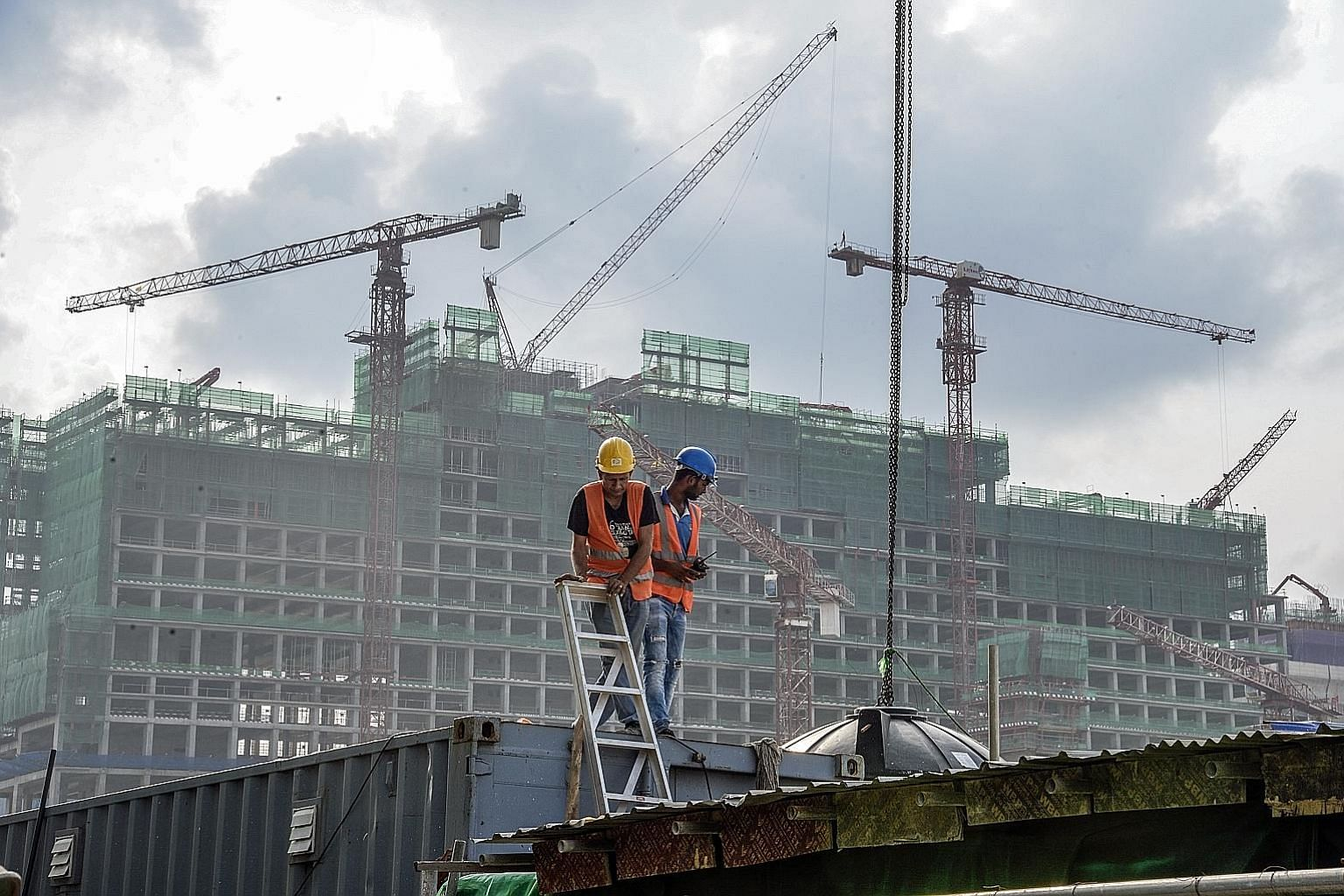 Workers at a project developed by China Harbour Engineering in Sri Lanka. The country has been forced into debt-for-equity arrangements, with China taking over operations at Hambantota Port, which it helped finance and build, after the government str