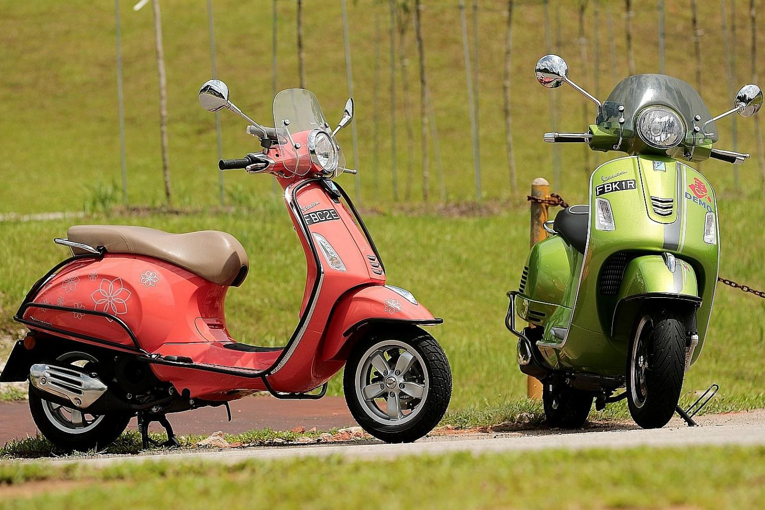 The 2018 Vespa Primavera 150 (left) may have a smaller engine than the GTS Super 300, but it is a lot lighter and has better fuel economy than its more powerful sibling.