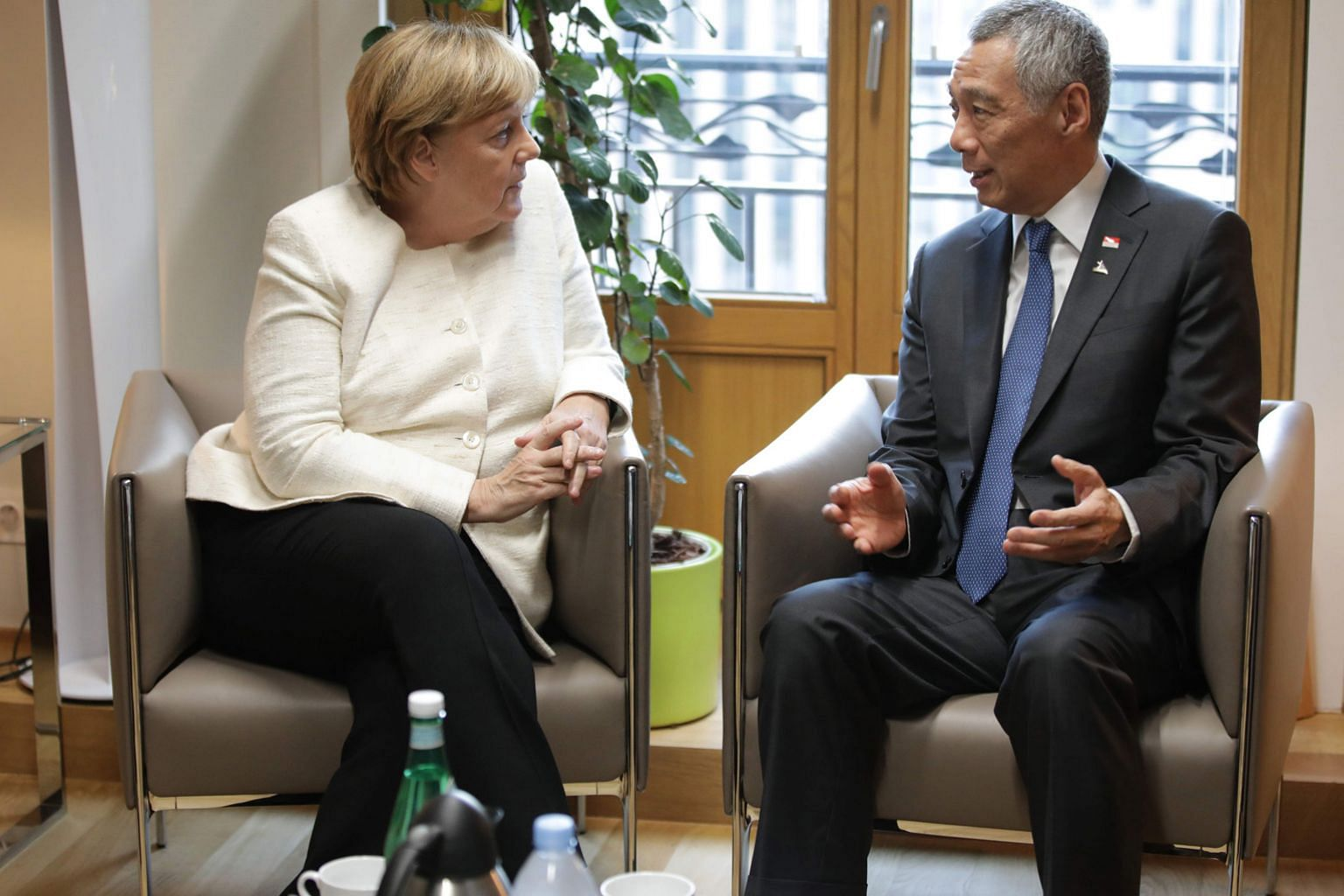 Prime Minister Lee Hsien Loong meeting German Chancellor Angela Merkel (left) and British Prime Minister Theresa May in Brussels on Thursday, where they underscored their commitment to the multilateral system.
