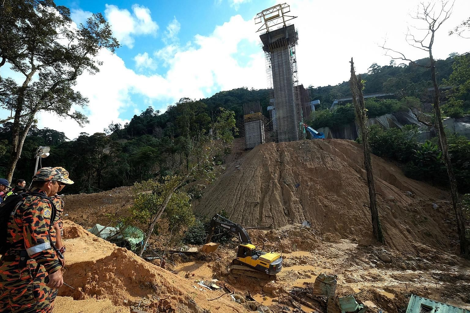 Search and rescue operations yesterday at a construction site hit by a landslide in Penang. It is believed that construction sites are not following the soil erosion mitigation plan stipulated in their project approvals.
