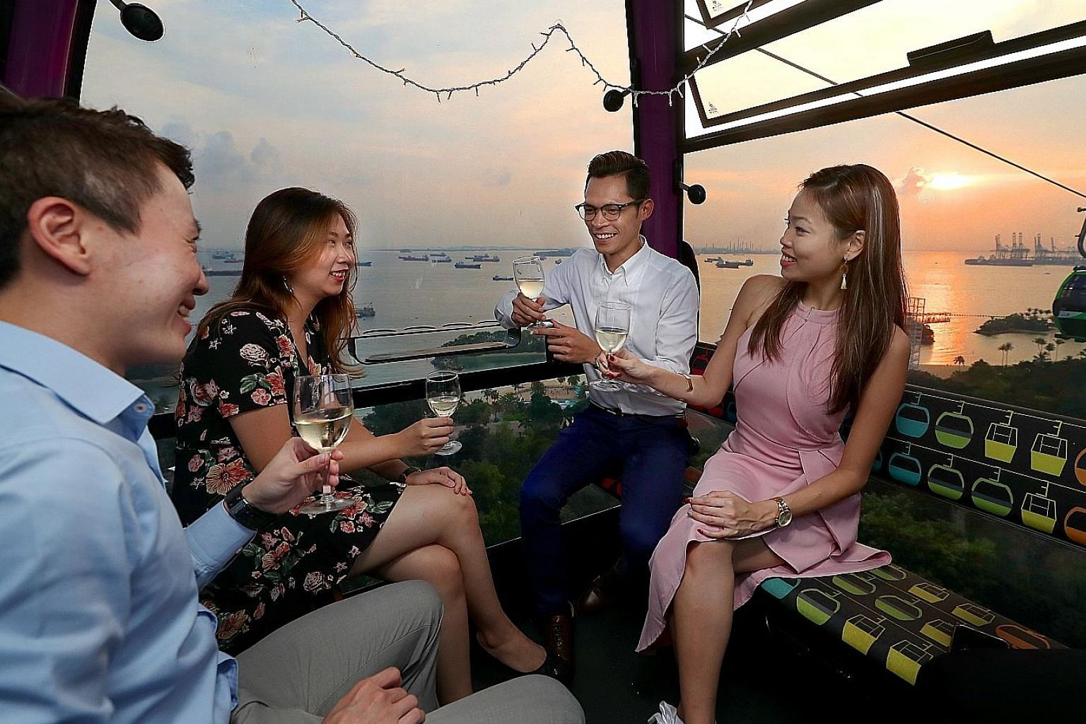 This posed photo shows how participants of an upcoming Love In The Air speed-dating event will get to meet other singles in cable cars decked out with fairy lights under the evening sky. Above: A workshop organised by Dating Moments for singles who a