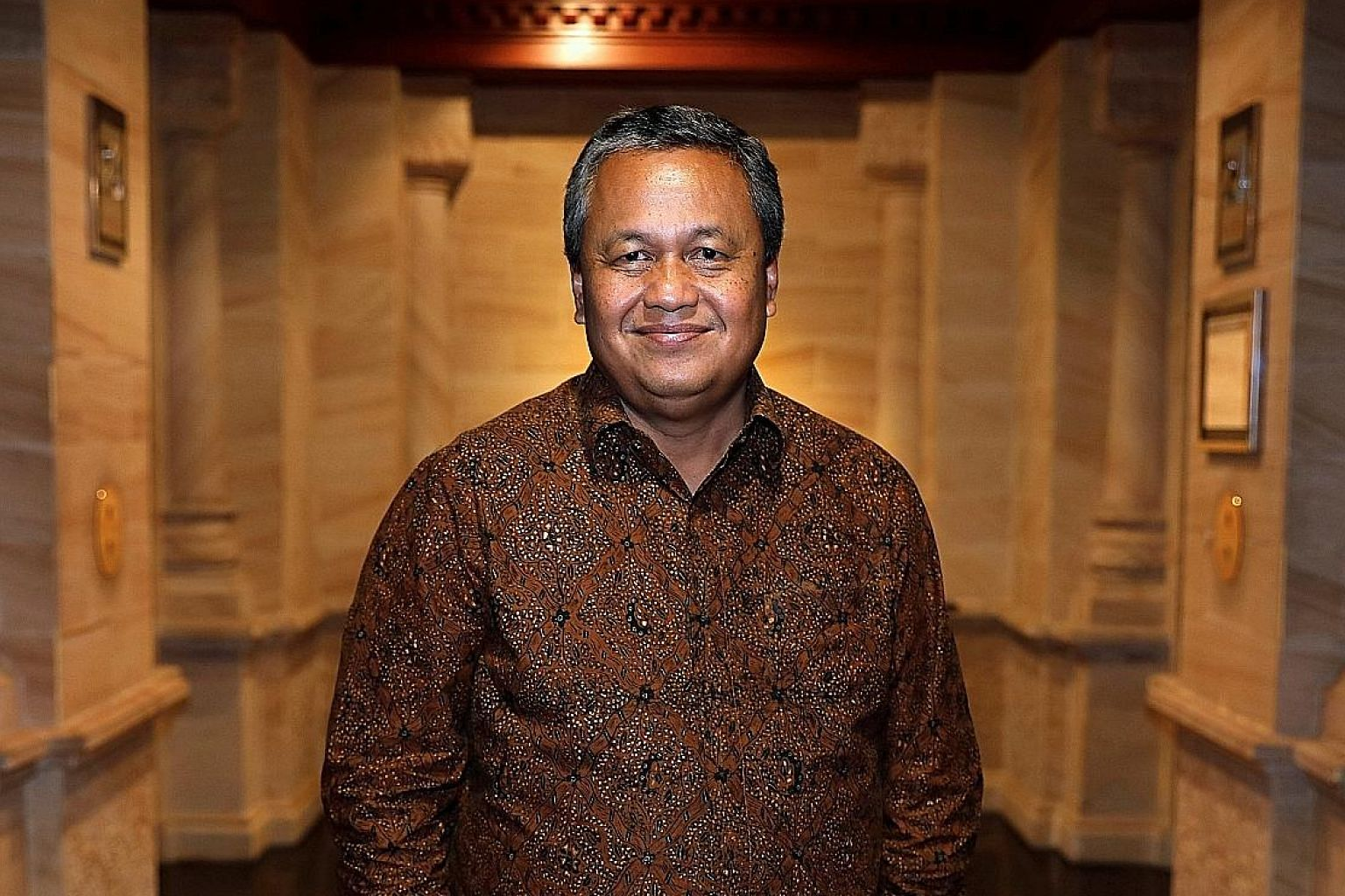 Bank Indonesia governor Perry Warjiyo, seen here at the central bank's headquarters in Jakarta, has been credited with doing the best he can to manage the volatile rupiah after assuming office in May, through measures such as imposing rate hikes and