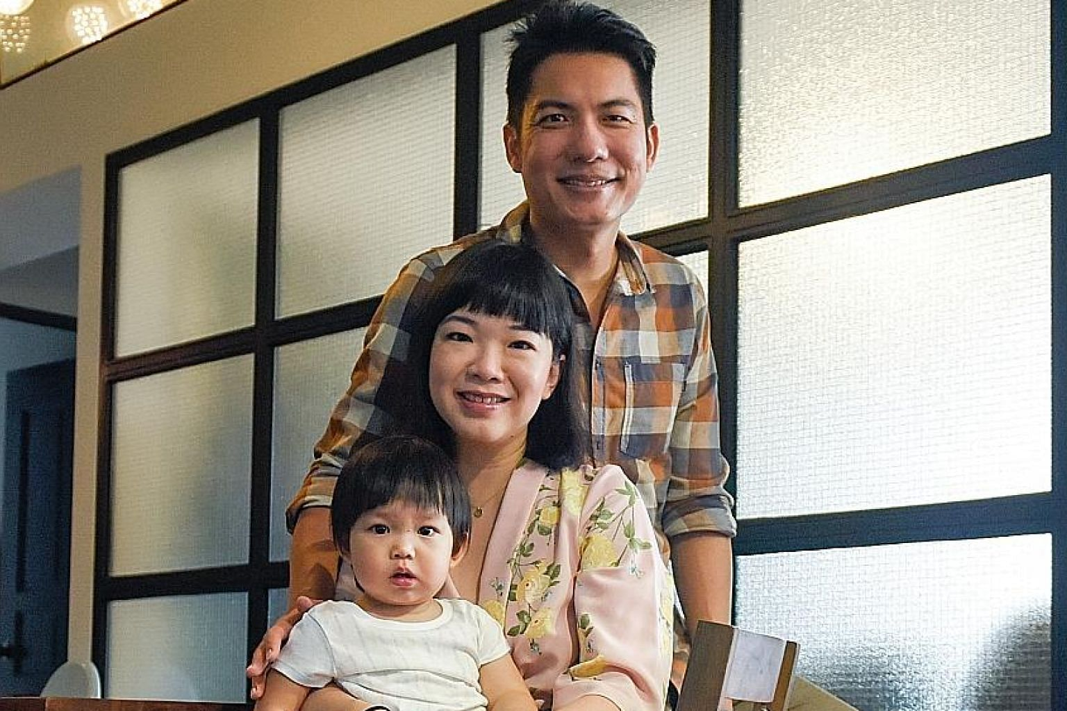 SPH Radio presenter Ryan Huang with his wife Licia Sucipto and daughter Raelynn.