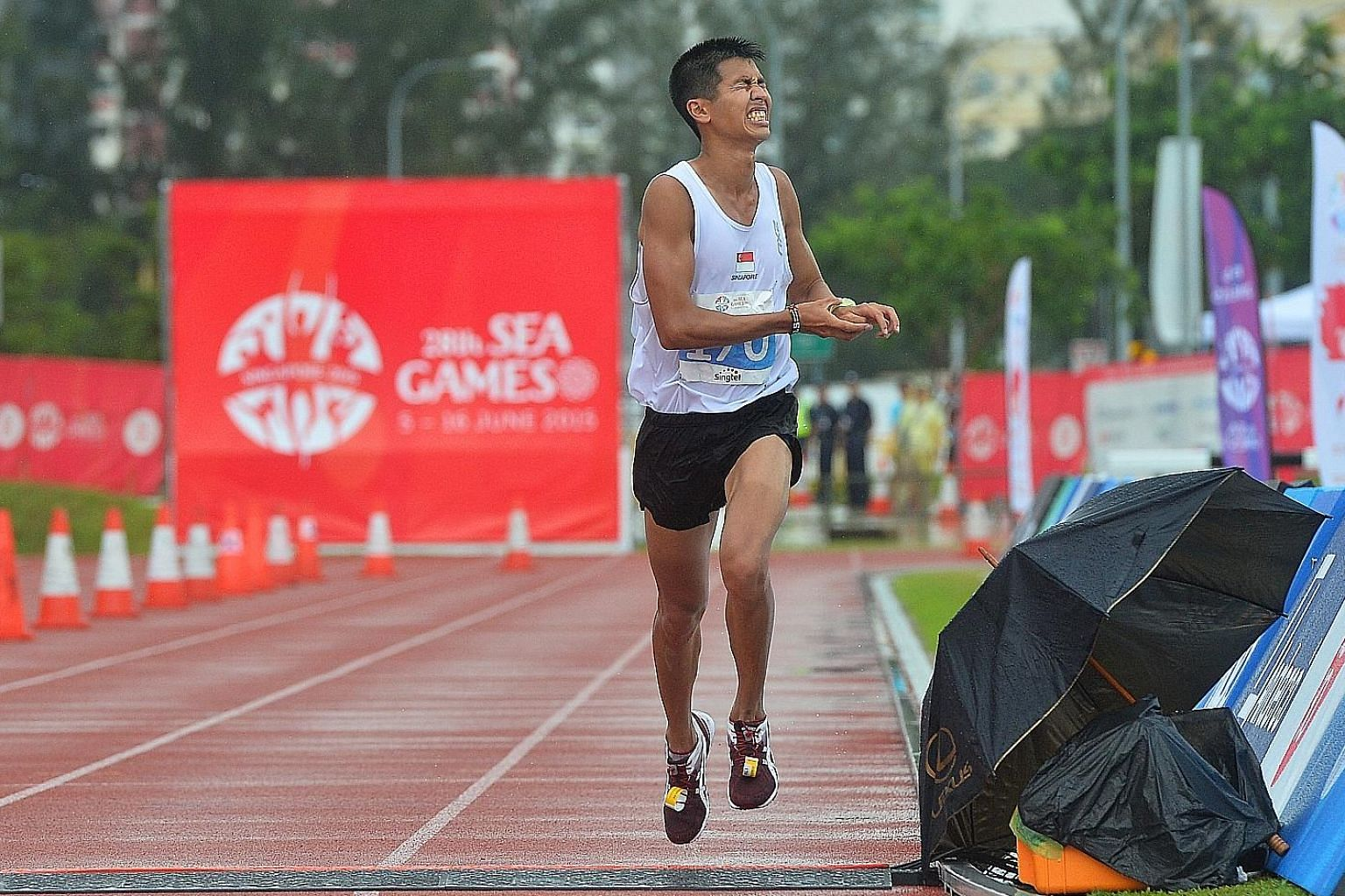 Singapore's Ashley Liew finishing eighth in the 2015 SEA Games marathon in Singapore. Liew's actions, in slowing down to give his rivals time to catch up after missing a U-turn, won him the 2016 World Fair Play Trophy.