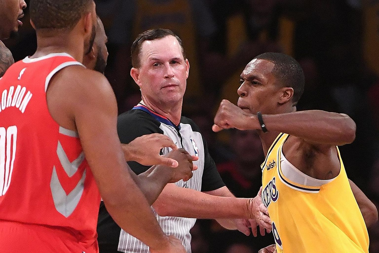 Los Angeles Lakers guard Rajon Rondo (No. 9) throws a punch at Houston Rockets guard Chris Paul during the fight in the fourth quarter at Staples Centre.