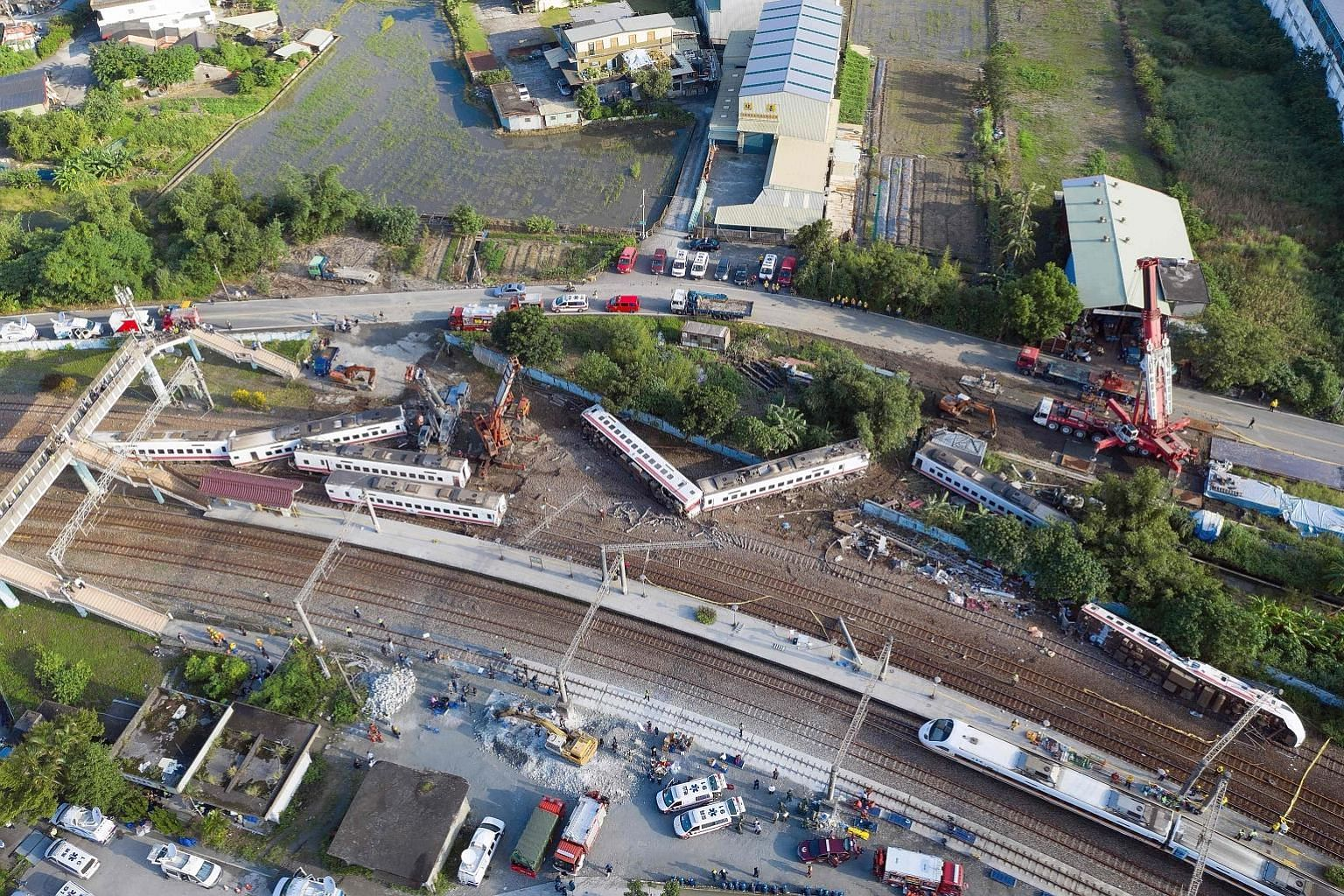 An aerial view of the Puyuma Express train, which was carrying 366 people. All eight of the train's cars derailed.