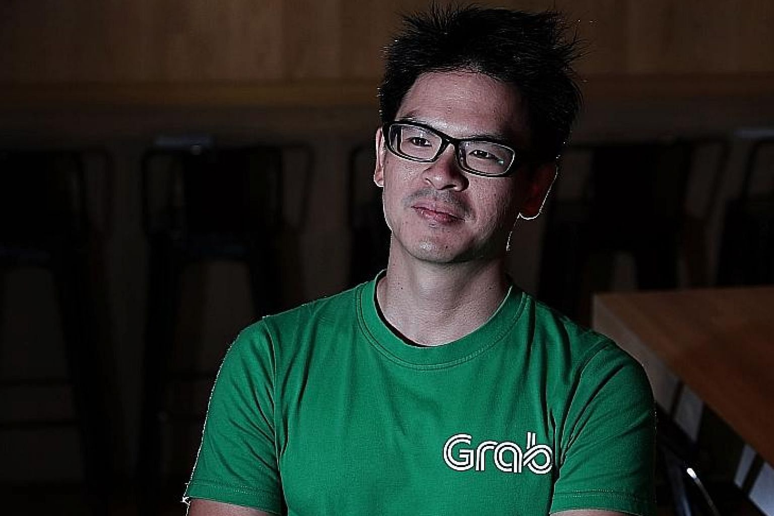 """Mr Lim Kell Jay, head of Grab Singapore, says the aim is to be an """"everyday super app"""" - where customers """"will not only be able to book a ride, but order food, pay for stuff... all the things you typically do every day""""."""