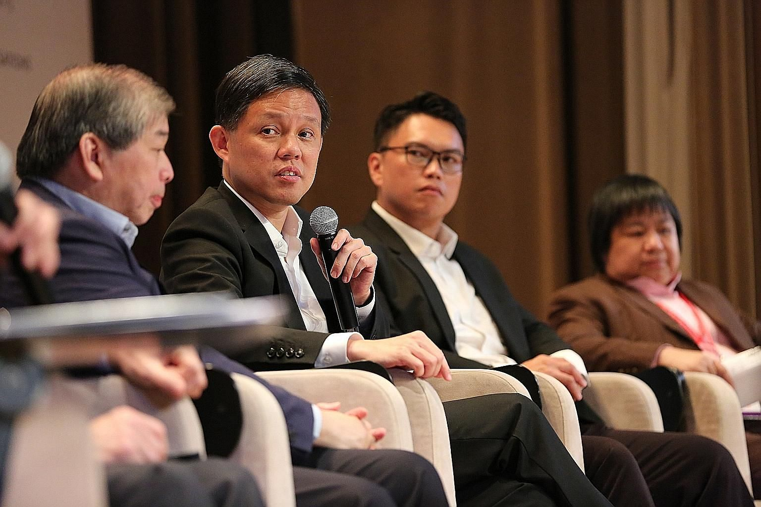(From left) Singapore Business Federation chairman Teo Siong Seng, Trade and Industry Minister Chan Chun Sing, NTUC assistant secretary-general Patrick Tay and Accenture senior managing director for Asean Teo Lay Lim at a panel discussion yesterday a