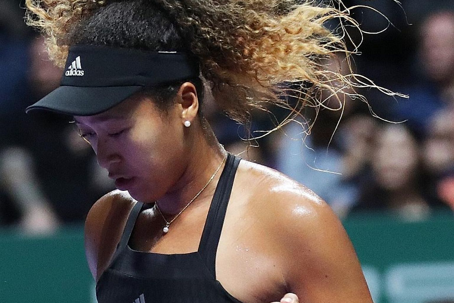 Naomi Osaka is half-Haitian, half-Japanese and now fully adopted by Asia. She is, one might say, a later model Li Na, an Asian charmer in her own right.
