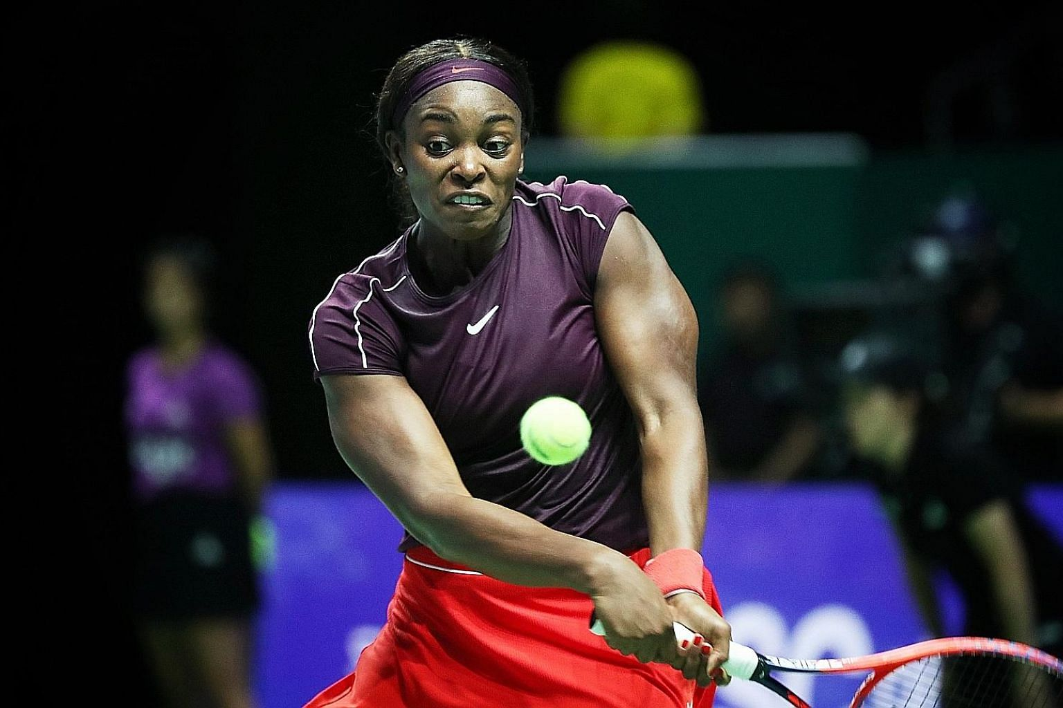 World No. 6 Sloane Stephens hitting a return to No. 4 Naomi Osaka in their opening Red Group match at the BNP Paribas WTA Finals Singapore presented by SC Global at the Indoor Stadium last night. The American won 7-5, 4-6, 6-1.