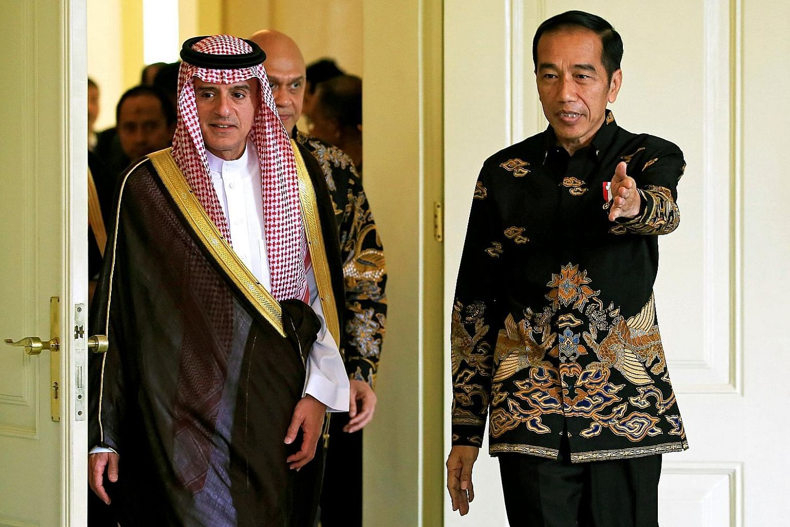 Indonesian President Joko Widodo welcoming Saudi Foreign Minister Adel al-Jubeir to the presidential palace in Bogor, West Java, yesterday. Mr al-Jubeir's visit is a follow-up to that of Saudi King Salman in March last year.