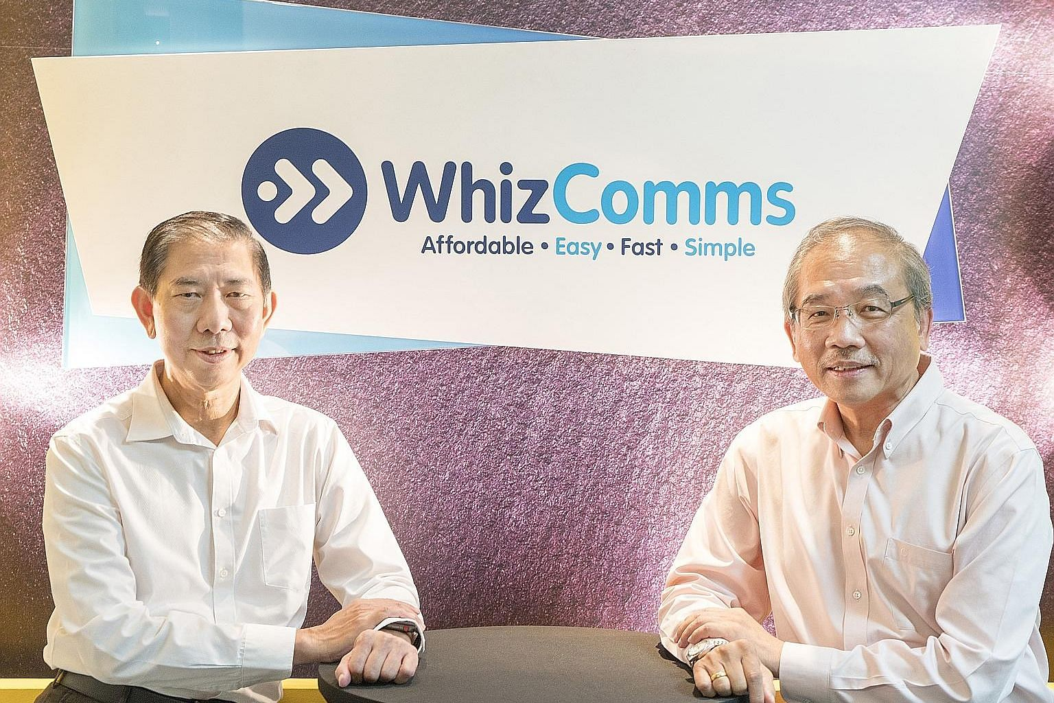 Mr Chiang Chee Cheong (left), managing director of WhizComms, and Mr Jason Kuek, deputy managing director of WhizComms, started the fibre broadband company two years ago.