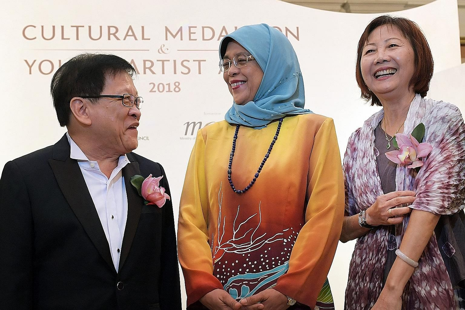 Cultural Medallion recipients Louis Soliano, a jazz musician, and Low Mei Yoke, a dance choreographer, with President Halimah Yacob at the Istana yesterday. The Young Artist Award was also given out at yesterday's ceremony.