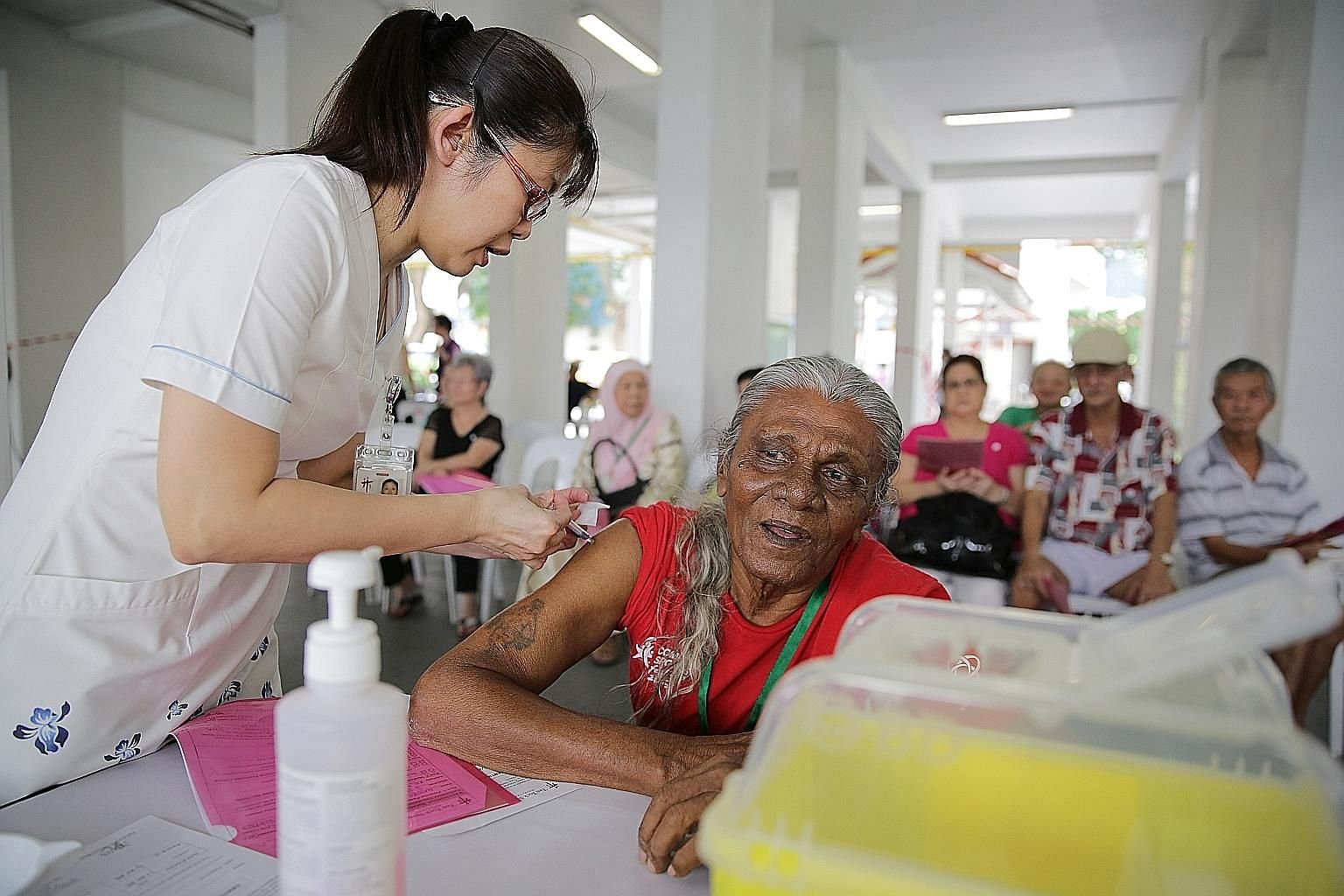 A vaccination session by Tan Tock Seng Hospital in 2015. The flu jab study, by the National Centre for Infectious Diseases and Tan Tock Seng Hospital, had 200 participants aged 65 and up. Its findings could help determine how often people here should