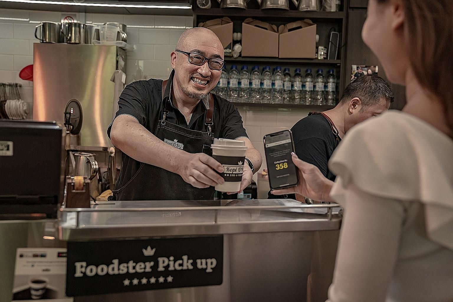 Mr Alfred Tan, director of Kopi Ong, said DBS Foodster accounts for more than 15 per cent of all his orders. Kopi Ong is one of seven outlets at Marina Bay Link Mall that have joined Foodster so far. The service lets users pre-order food and drinks v
