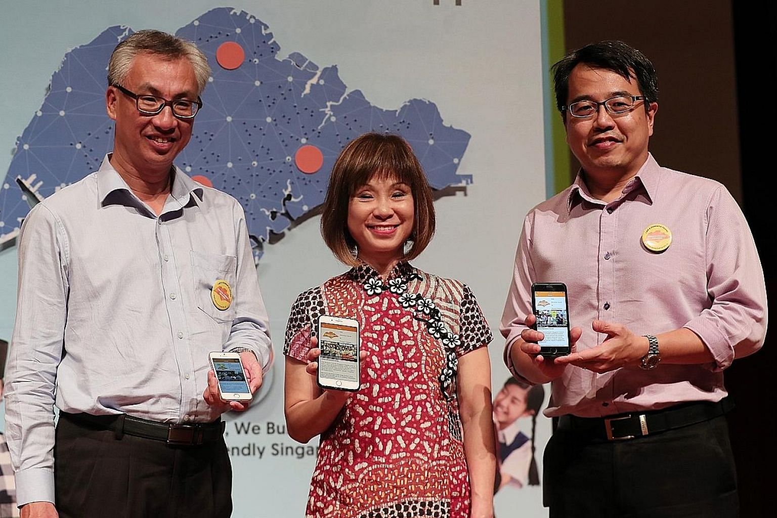 Senior Minister of State for Health Amy Khor with Tote Board senior director of corporate services Yong Fook Chyi (left) and Agency for Integrated Care deputy chief executive Tan Kwang Cheak during the launch of the Dementia Friends app yesterday. Th