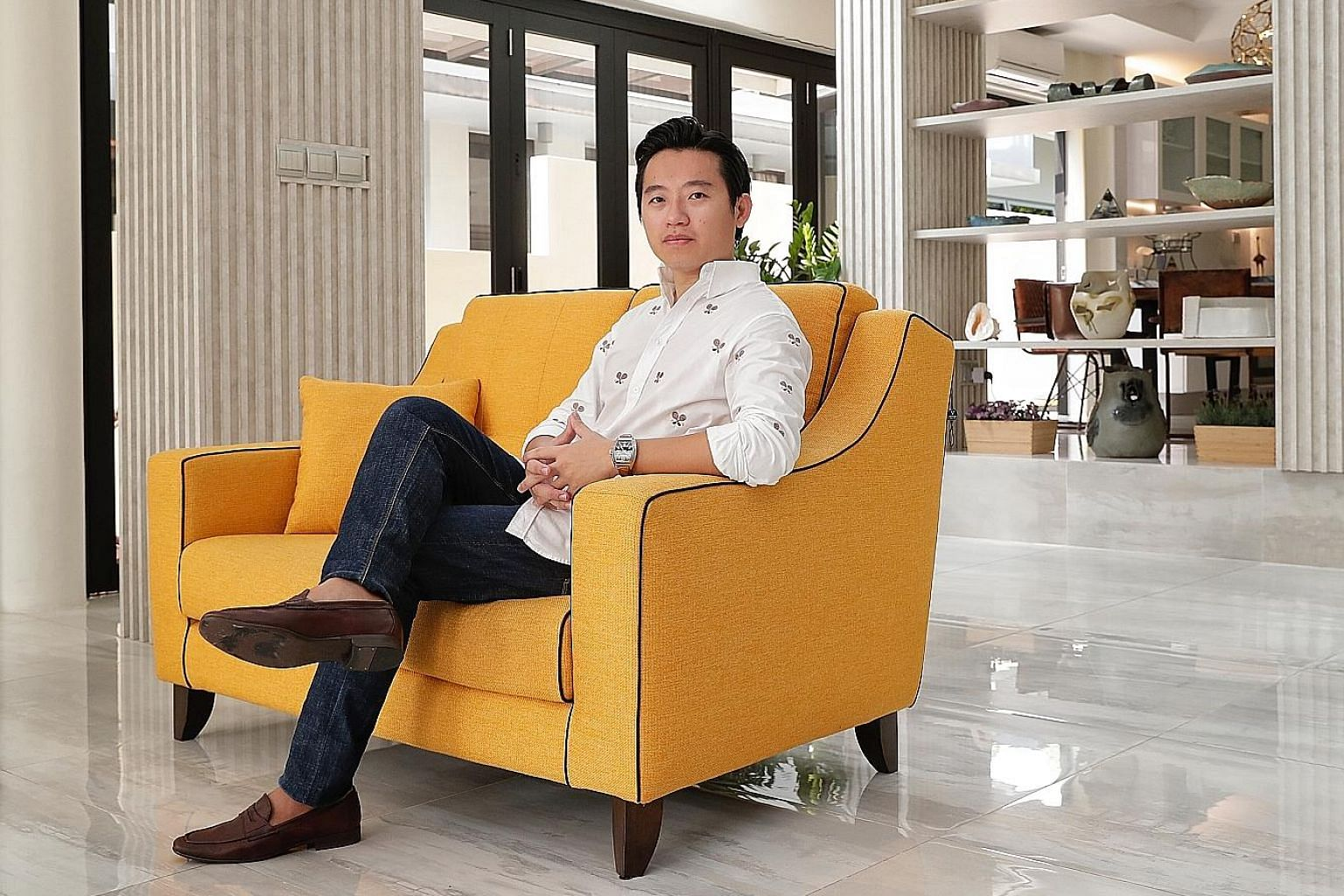 Mr Ezekiel Chew says his Asiaforexmentor business allows him to focus on trading and teaching - two of his passions.